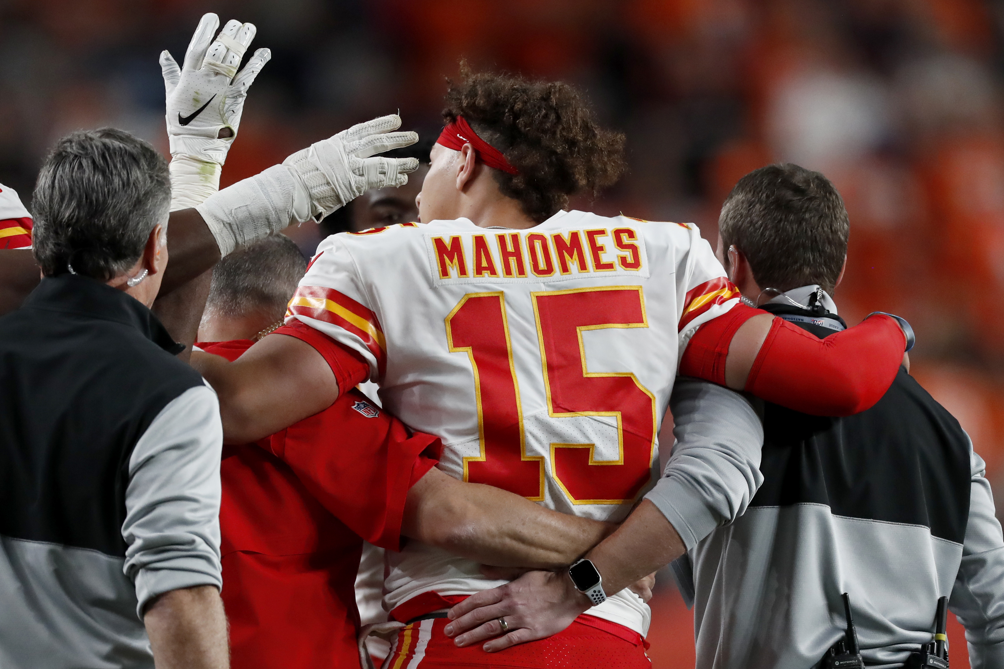 Chiefs quarterback Patrick Mahomes is helped off the field after getting injured against the Broncos on Thursday in Denver. (AP Photo/David Zalubowski)