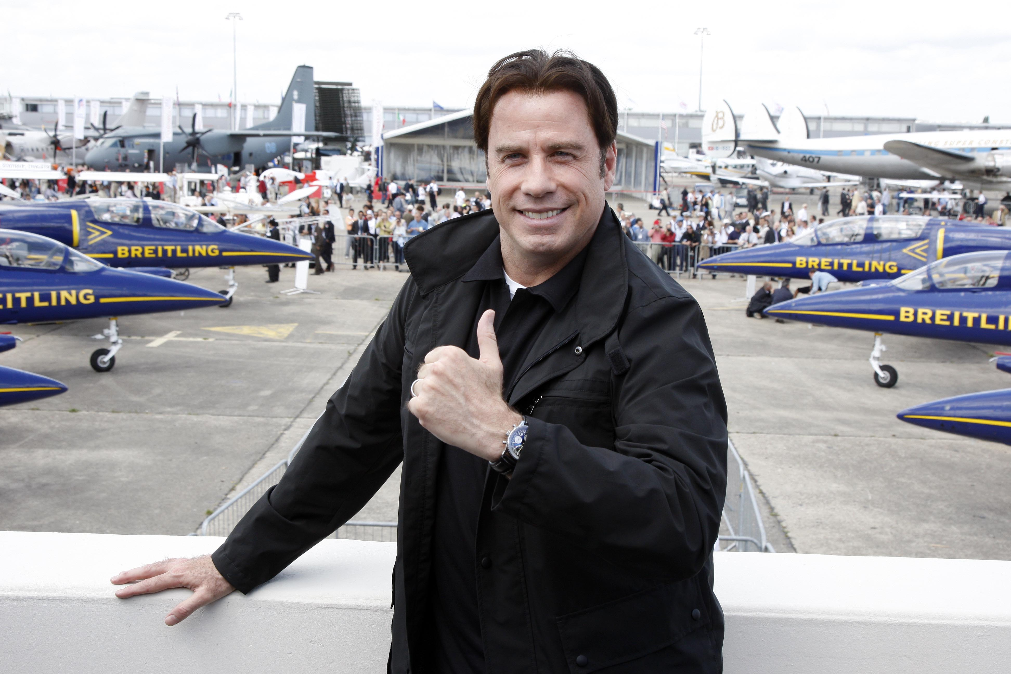 LE BOURGET, FRANCE- JUNE 21:  Hollywood actor and pilot John Travolta attends the 47th International Paris Air Show on June 21, 2007 in Le Bourget France. Travolta, invited by Breitling, witnessed the presentation of Airbus A380 superjumbo and Boeing's F/A-18 fighter jet.  (Photo by Michel Dufour/WireImage)