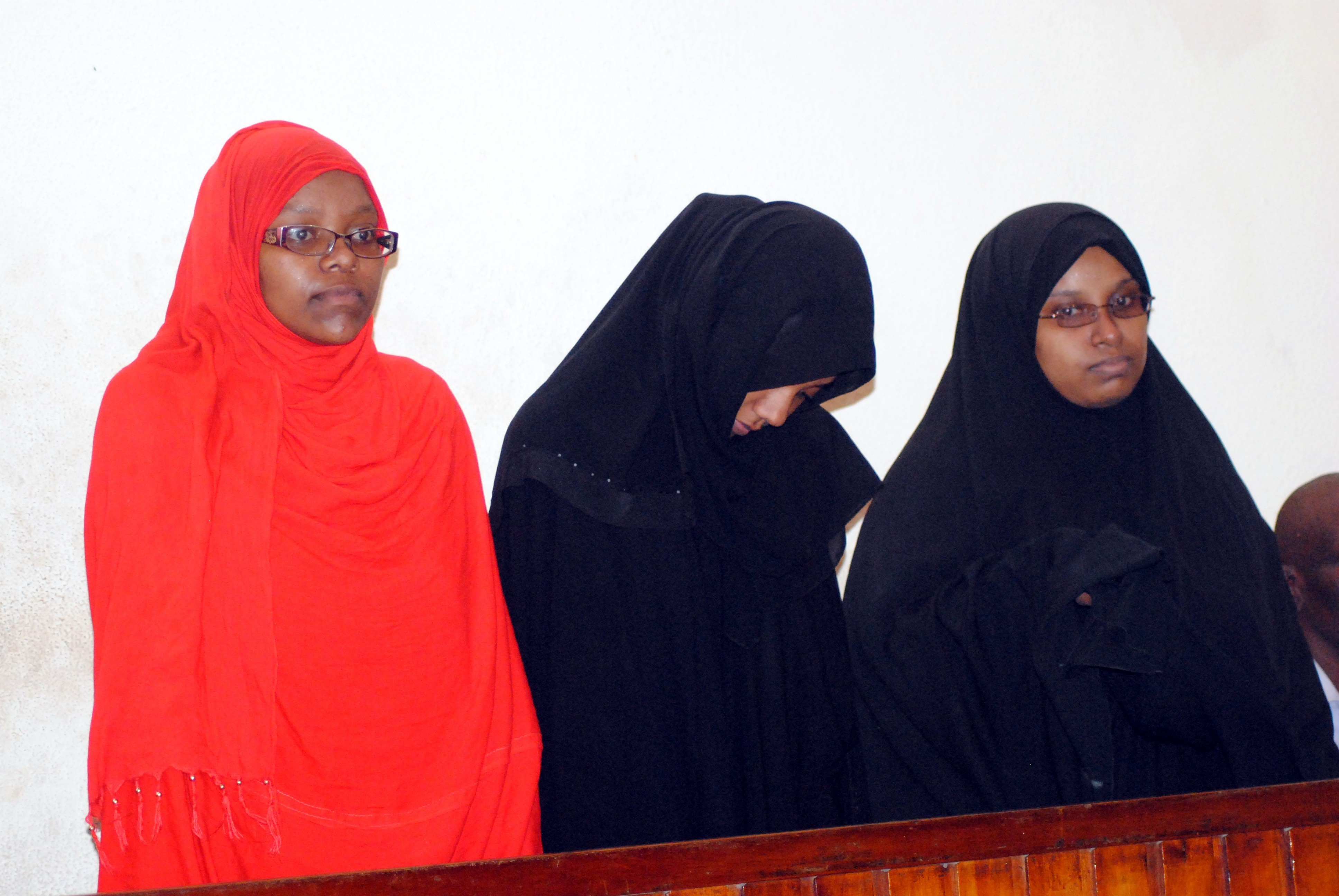 MOMBASA, KENYA - MARCH 30: Three women on Monday were brought before a court in Kenya's coastal city of Mombasa on March 30, 2015 after having been arrested by security forces at the border with Somalia for allegedly planning to travel to Syria. The three young women, one Tanzanian and two Kenyans, were arrested on Saturday near El Wak, a Kenyan town less than 10km from the Somali border. (Photo by Yassin Juma/Anadolu Agency/Getty Images)