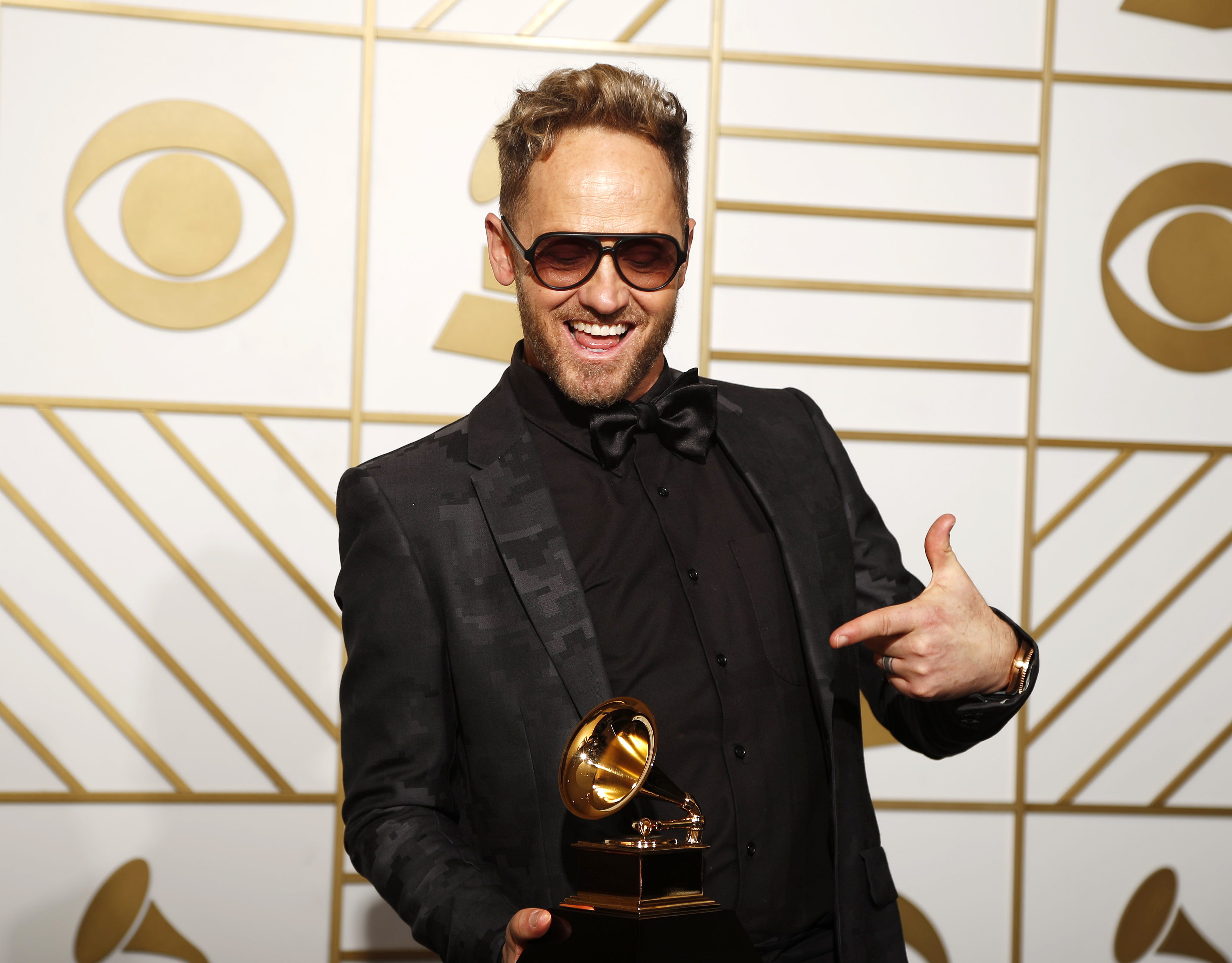 "Tobymac holds the award for Best Contemporary Christian Music Album for ""This Is Not A Test"" during the 58th Grammy Awards in Los Angeles, California February 15, 2016.  REUTERS/Lucy Nicholson"