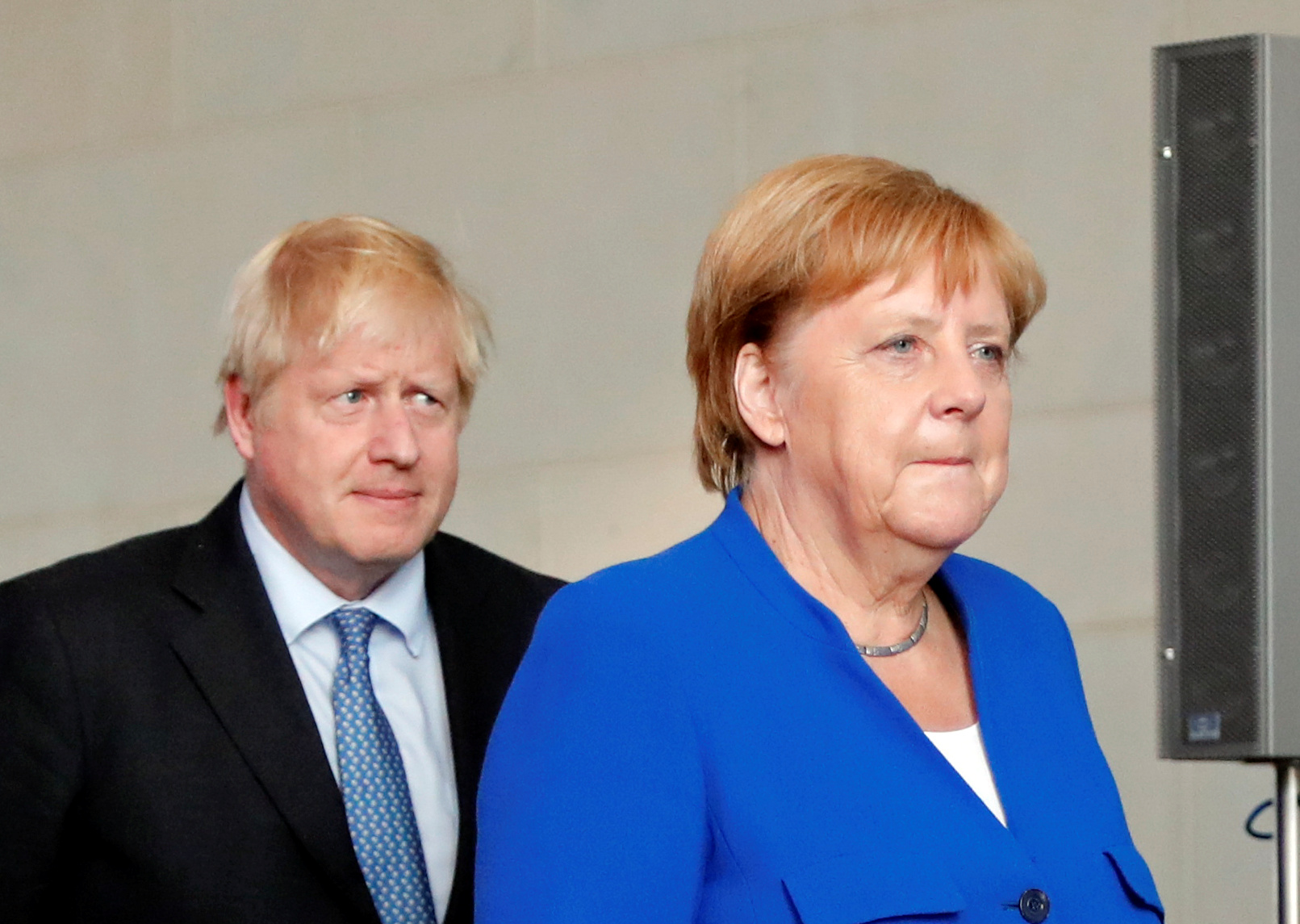 Britain's Prime Minister Boris Johnson and German Chancellor Angela Merkel are seen ahead of their news conference at the Chancellery in Berlin, Germany August 21, 2019. REUTERS/Fabrizio Bensch