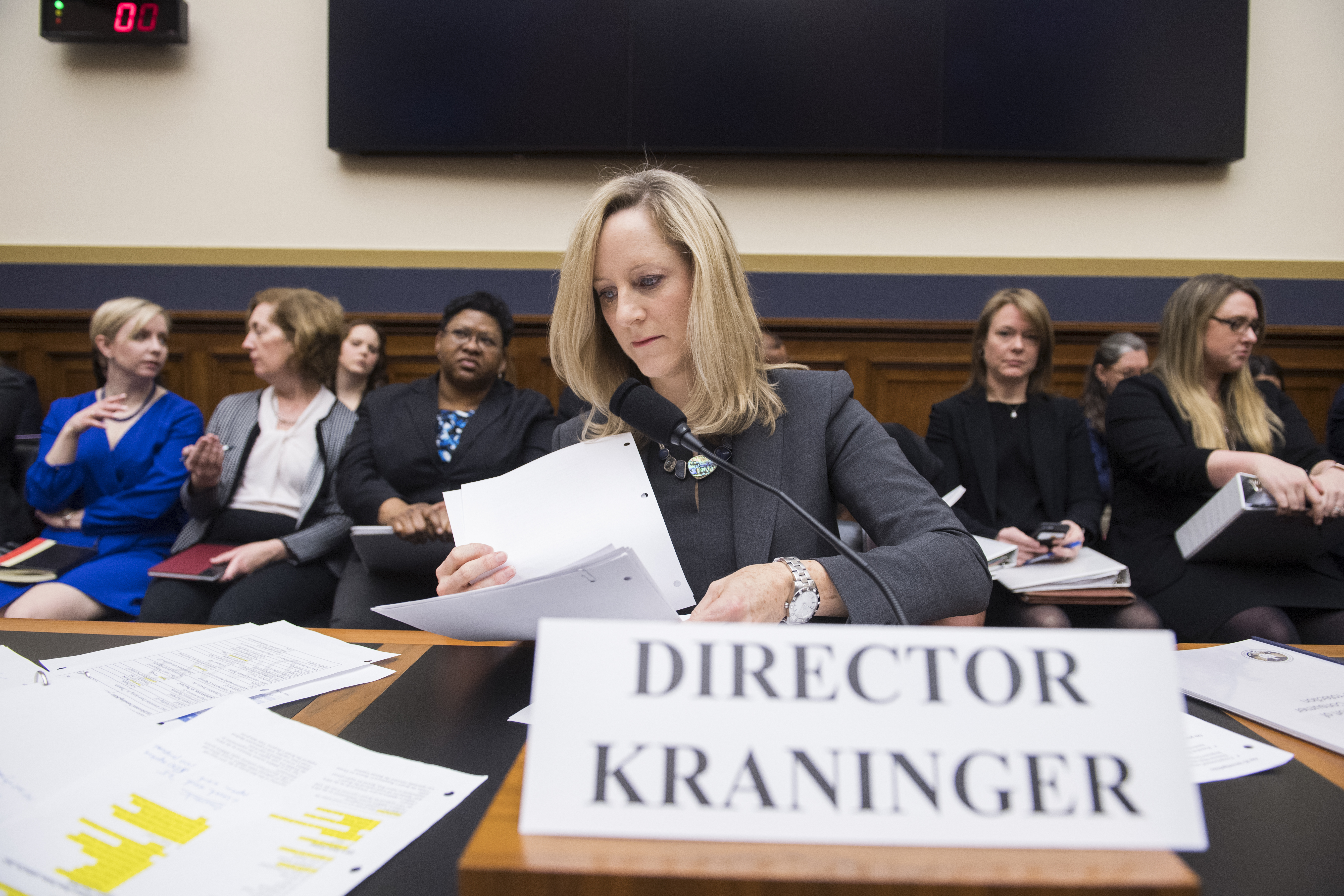 """UNITED STATES - MARCH 7: Kathy Kraninger, director of the Consumer Financial Protection Bureau, prepares to testify at a House Financial Services Committee hearing titled """"Putting Consumers First? A Semi-Annual Review of the Consumer Financial Protection Bureau,"""" in Rayburn Building on Thursday, March 7, 2019. (Photo By Tom Williams/CQ Roll Call)"""