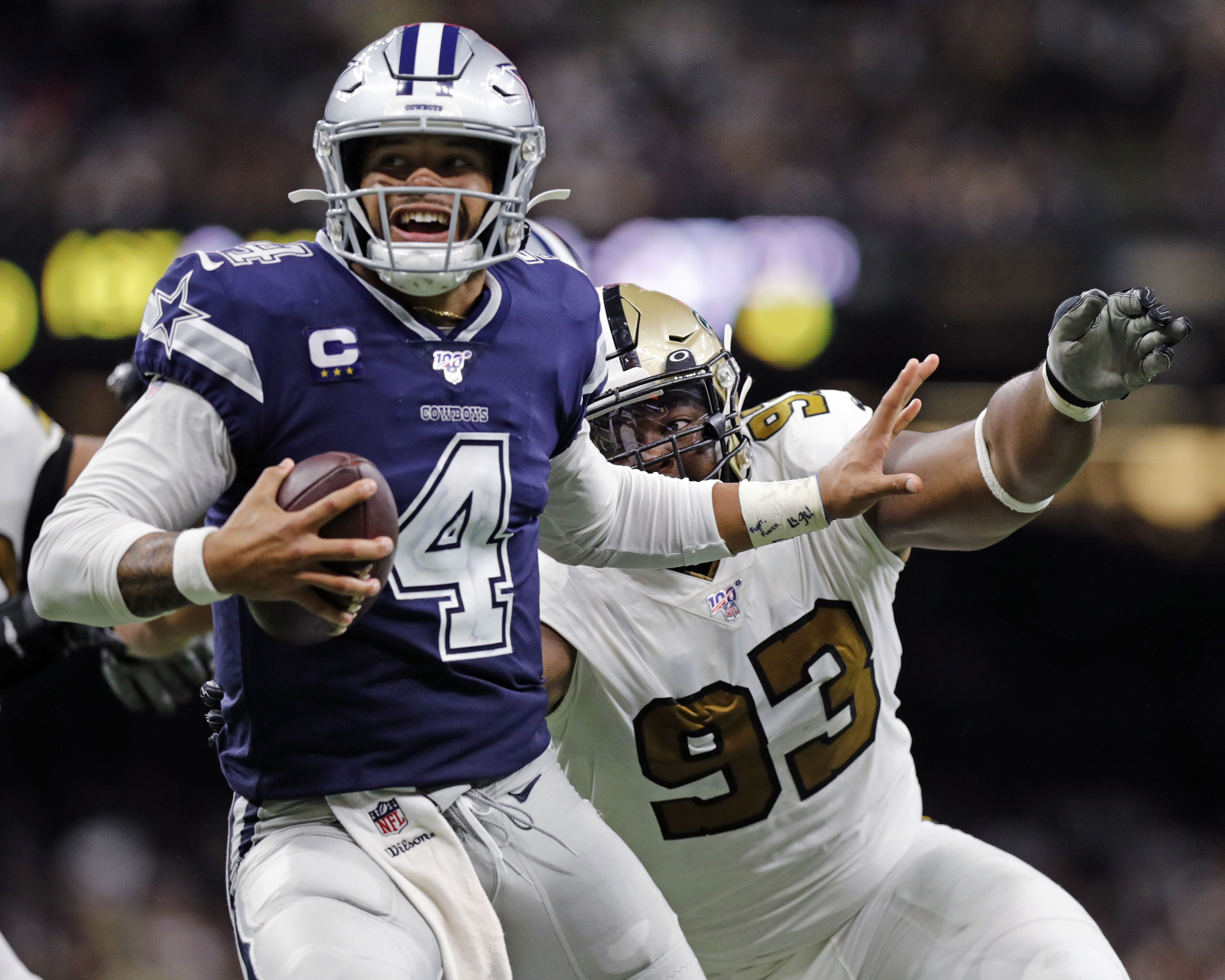 NEW ORLEANS, LA - SEPTEMBER 29:  New Orleans Saints defensive tackle David Onyemata (93) gets a sack against Dallas Cowboys quarterback Dak Prescott (4) during the game between the New Orleans Saints and the Dallas Cowboys on September 29, 2019 at the Mercedes-Benz Superdome in New Orleans, LA. (Photo by Stephen Lew/Icon Sportswire via Getty Images)