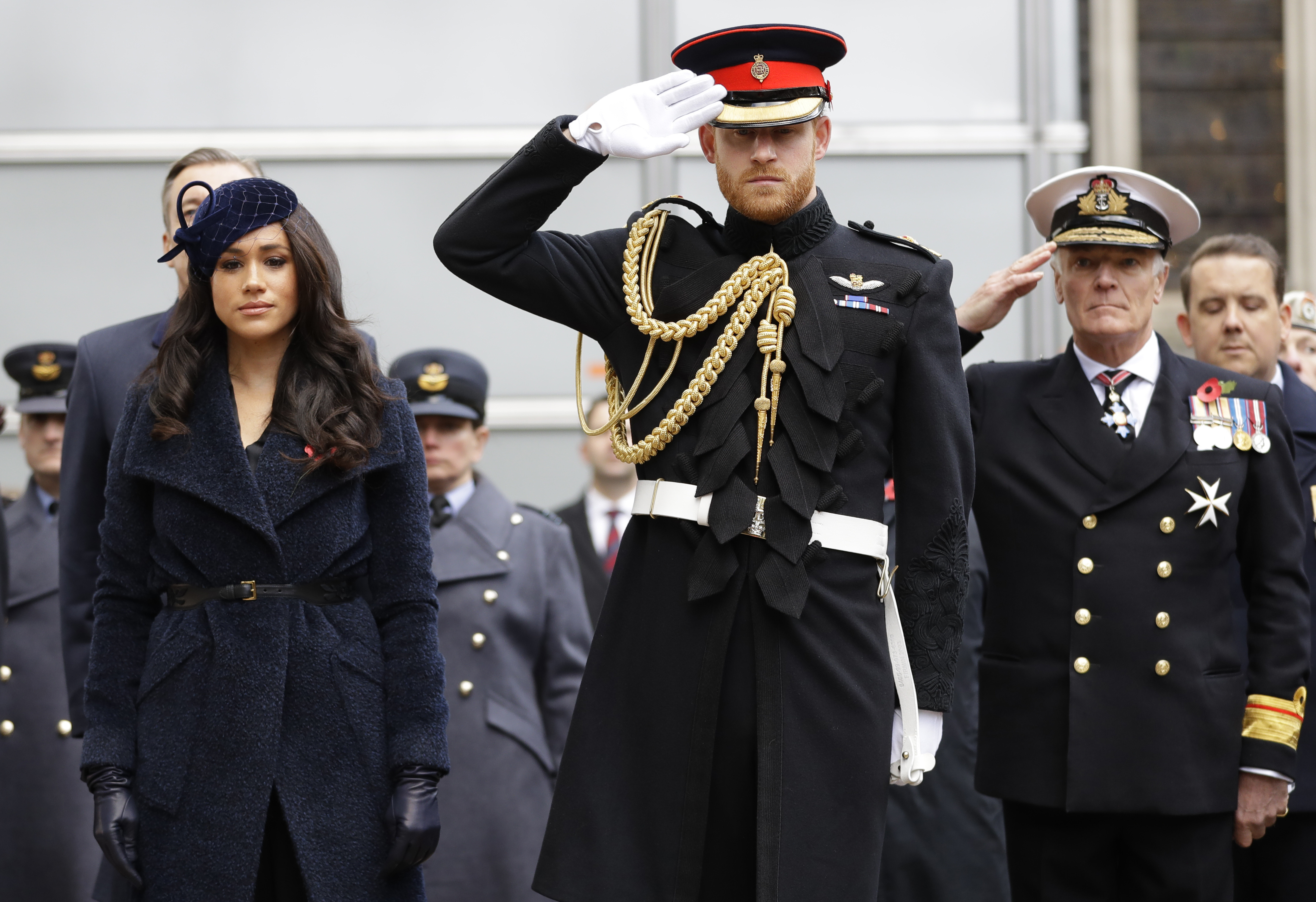 Britain's Prince Harry, Duke of Sussex and his wife Meghan, Duchess of Sussex pay their respects after laying a Cross of Remembrance in front of wooden crosses from the Graves of Unknown British Soldiers from the First and Second World Wars, during their visit to the Field of Remembrance at Westminster Abbey in central London on November 7, 2019. - The Field of Remembrance is organised by The Poppy Factory, and has been held in the grounds of Westminster Abbey since November 1928, when only two Remembrance Tribute Crosses were planted. In the run-up to Armistice Day, many Britons wear a paper red poppy -- symbolising the poppies which grew on French and Belgian battlefields during World War I -- in their lapels. (Photo by Kirsty Wigglesworth / POOL / AFP) (Photo by KIRSTY WIGGLESWORTH/POOL/AFP via Getty Images)