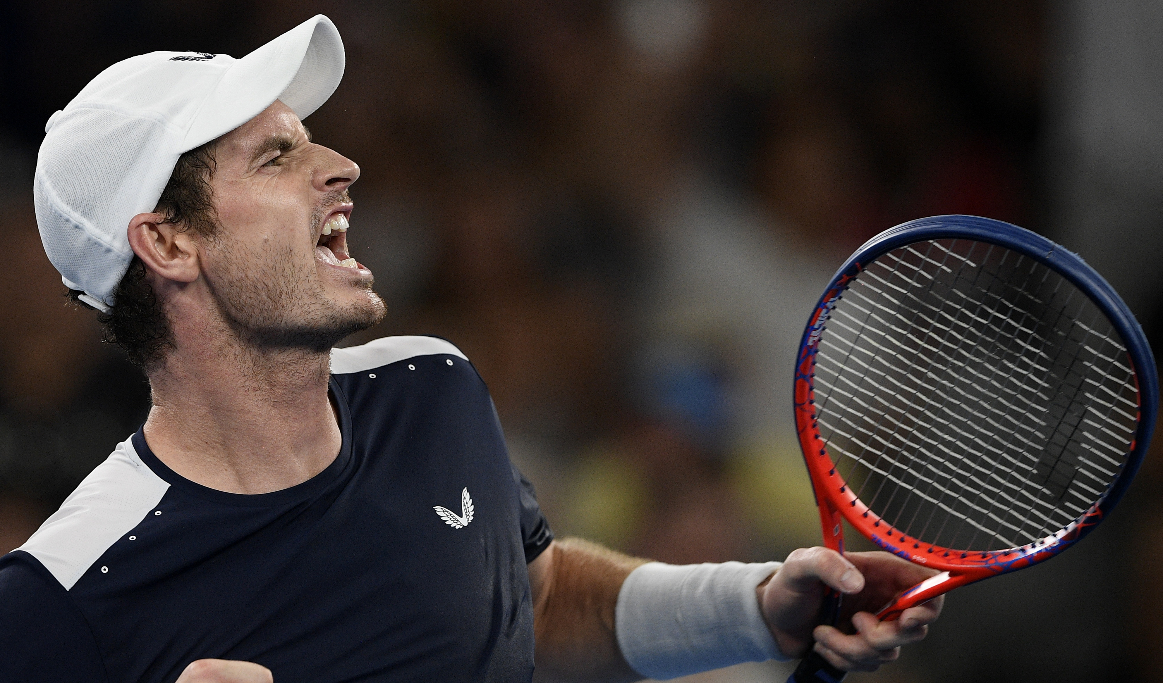 Britain's Andy Murray celebrates after winning the the third set tie-breaker against Spain's Roberto Bautista Agut during their first round match at the Australian Open tennis championships in Melbourne, Australia, Monday, Jan. 14, 2019. (AP Photo/Andy Brownbill)