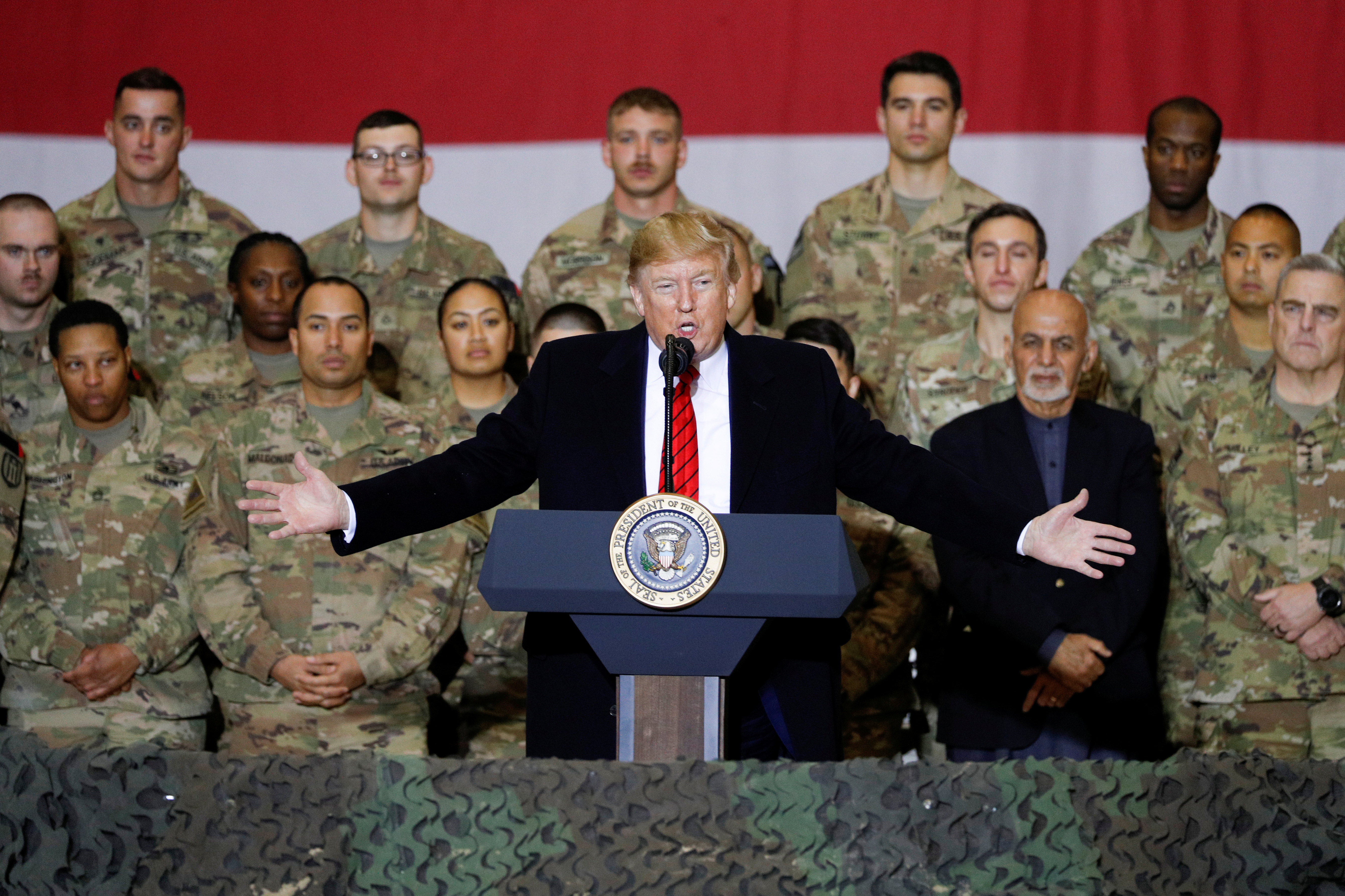 More U.S. troops leave Iraq over potential injuries as Trump downplays brain risk