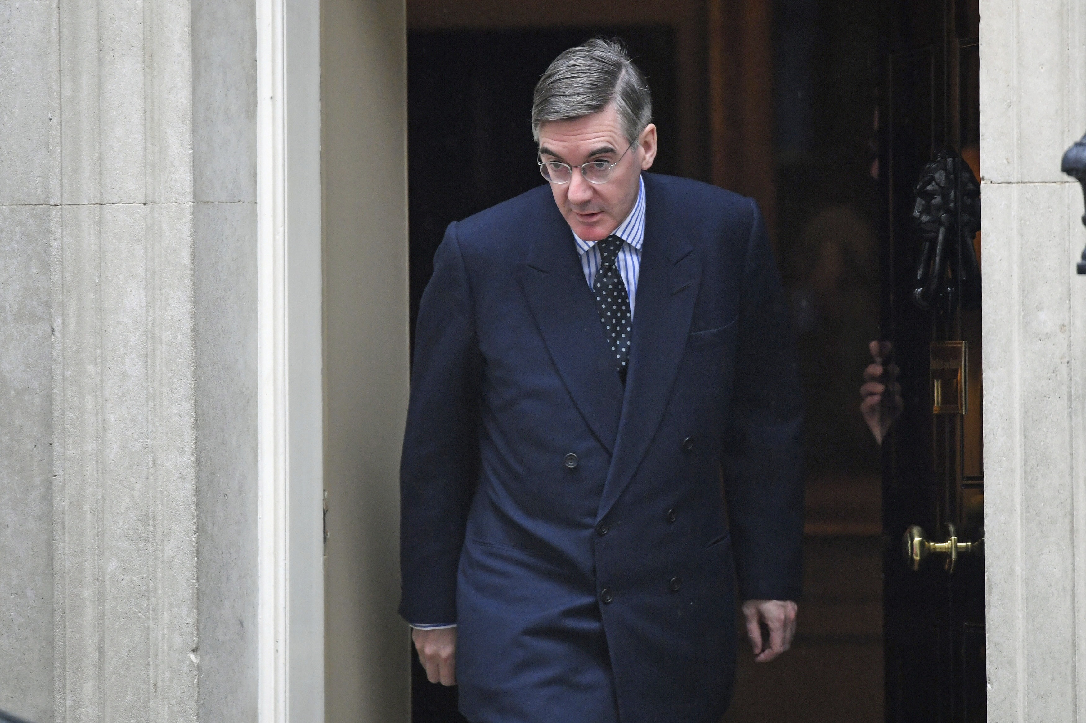 Leader of the House of Commons Jacob Rees-Mogg leaves 10 Downing Street, London, Monday Oct. 21, 2019. British Prime Minister Boris Johnson is expected to push for a vote on his European Union divorce deal as Parliament prepares for a week of guerrilla warfare over Brexit. (Stefan Rousseau/PA via AP)