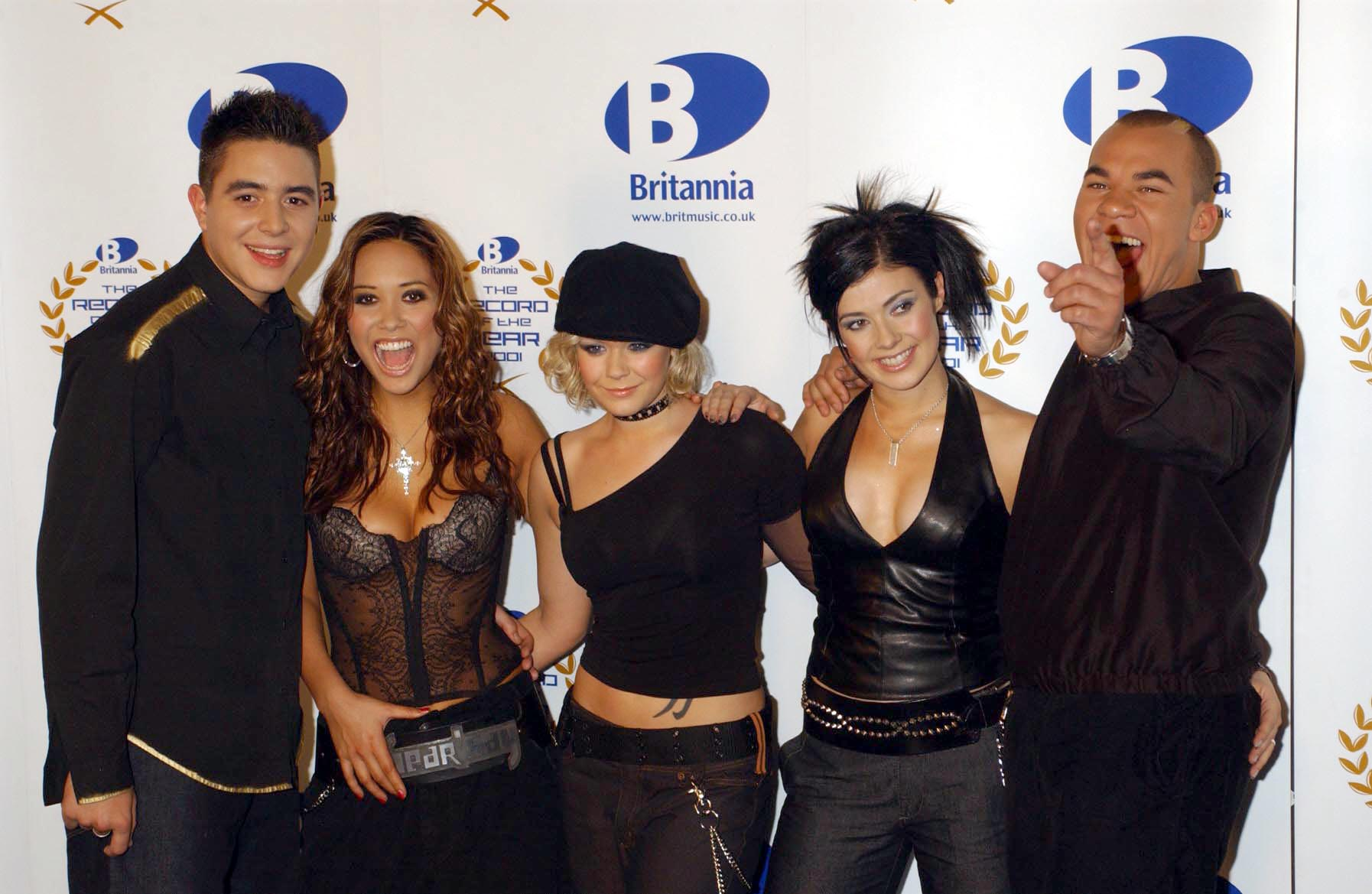 Pop group Hear'Say (from left) Noel Sullivan, Myleene Klass, Suzanne Shaw, Kym Marsh and Danny Foster pose for the media backstage at the Britannia Record of the Year ceremony at the London Television Centre.   (Photo by Yui Mok - PA Images/PA Images via Getty Images)