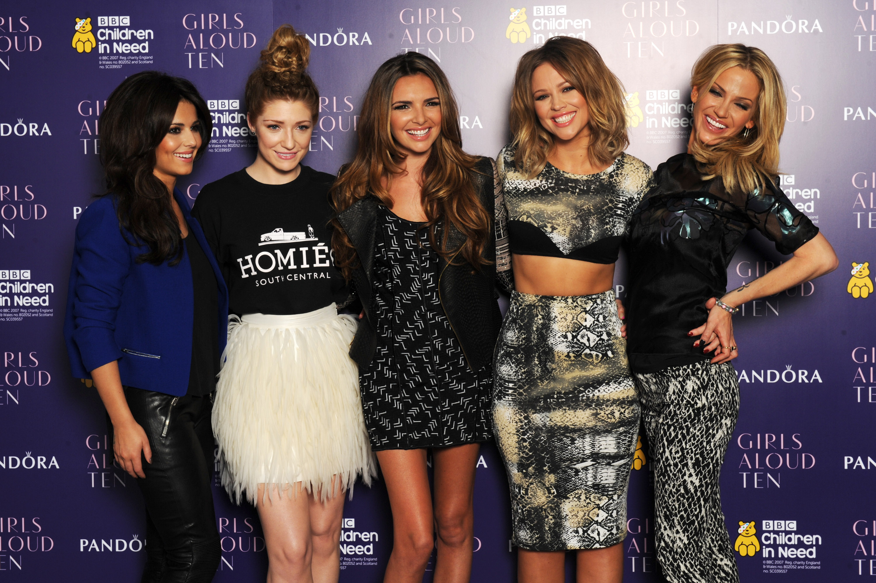 LONDON, ENGLAND - OCTOBER 19: (L-R) Cheryl Cole, Nicola Roberts, Nadine Coyle, Kimberley Walsh and Sarah Harding of Girls Aloud pose at a press conference to announce 'Girls Aloud Ten, The Hits Tour 2013' at The Corinthia Hotel on October 19, 2012 in London, England. (Photo by Dave J Hogan/Getty Images)