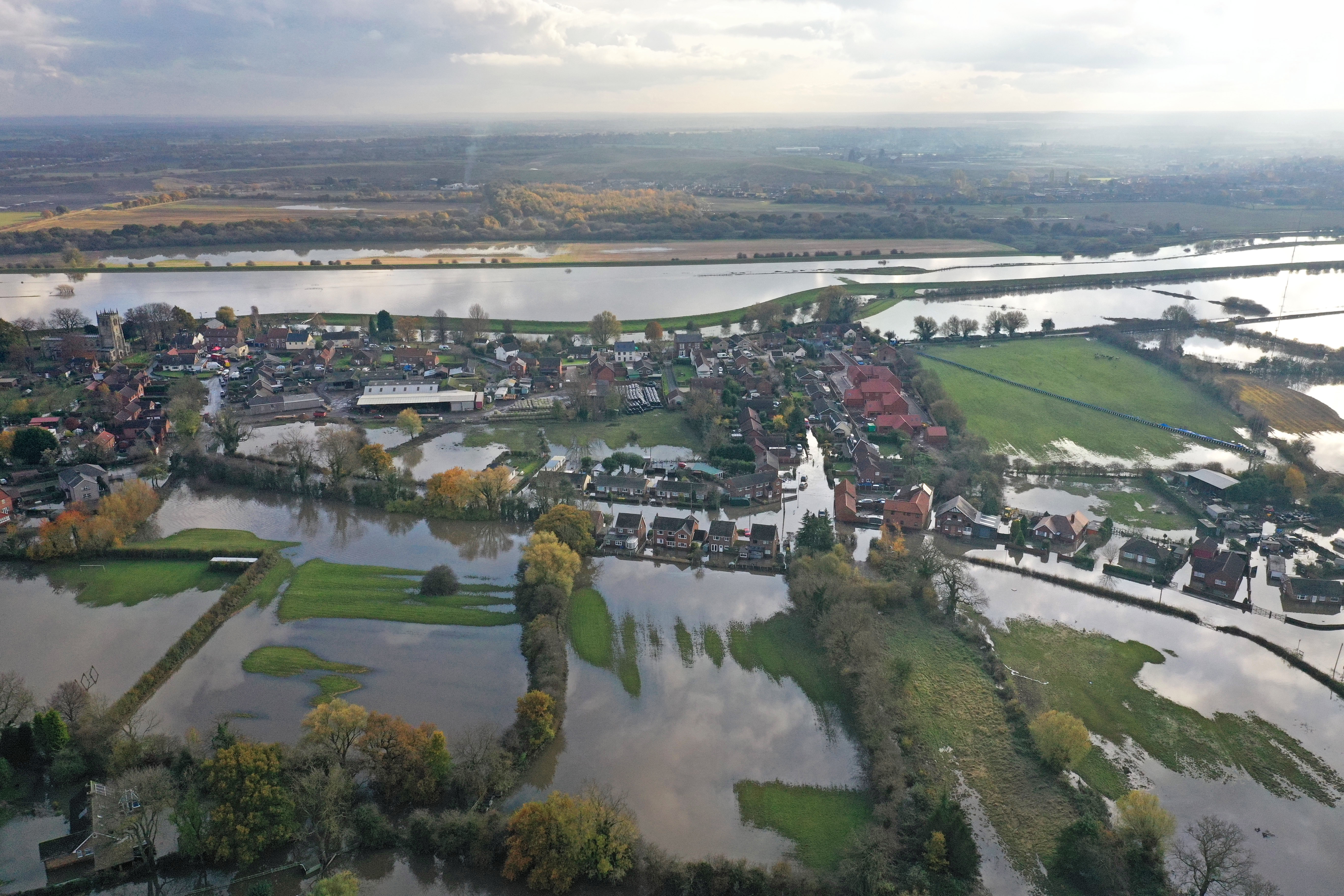 The flood water at Fishlake, in Doncaster, South Yorkshire, as parts of England endured a month's worth of rain in 24 hours, with scores of people rescued or forced to evacuate their homes.