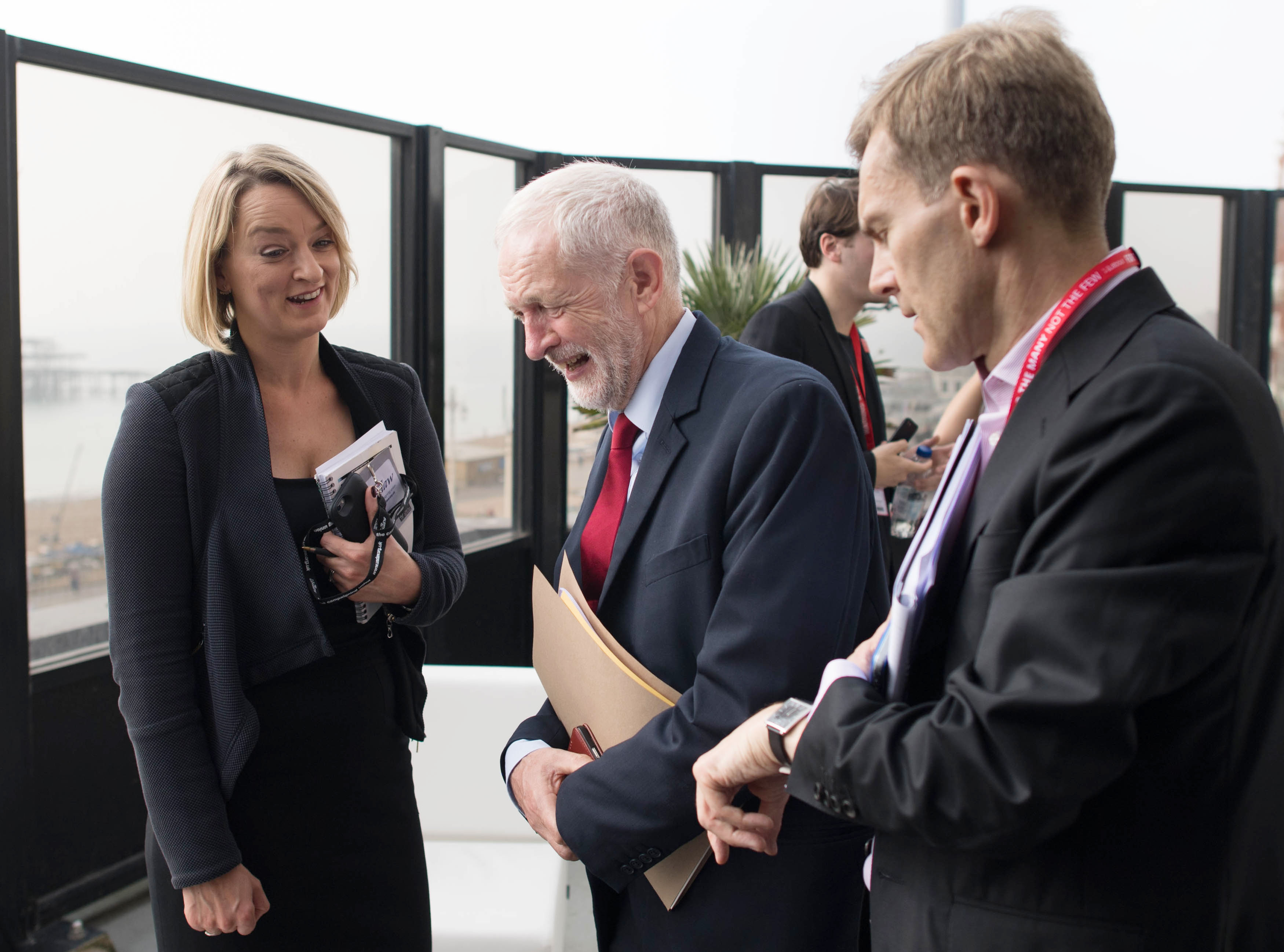 Labour Party leader Jeremy Corbyn (centre) talks with BBC political editor Laura Kuenssberg, whilst watched by advisor Seamus Milne, after an interview at the Labour Party annual conference, at the Brighton Centre, Brighton.