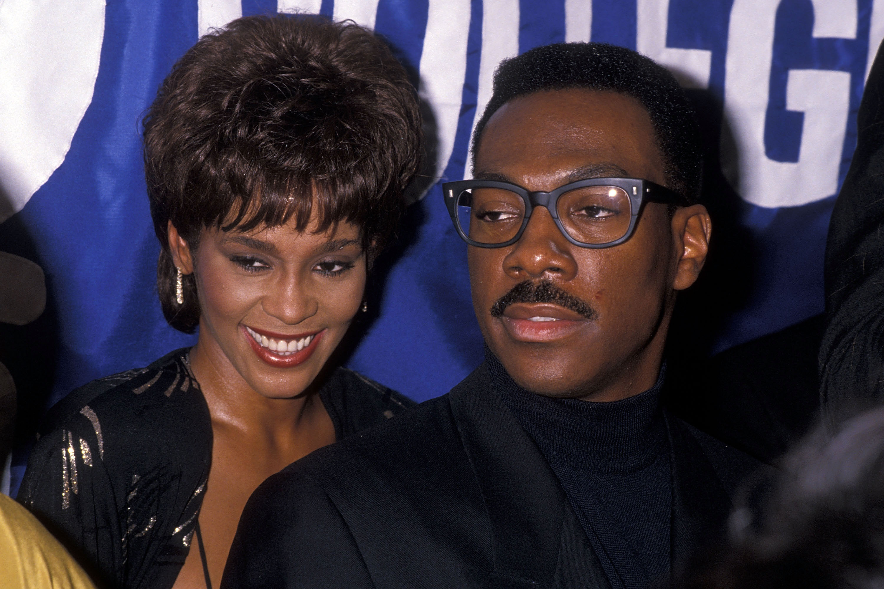 "Singer Whitney Houston and comedian/actor Eddie Murphy attend the United Negro College Fund's 10th Annual ""Lou Rawls Parade of Stars"" Telethon Kick-Off Party on November 15, 1989 at L'Ermitage in Beverly Hills, California. (Photo by Ron Galella, Ltd./Ron Galella Collection via Getty Images)"