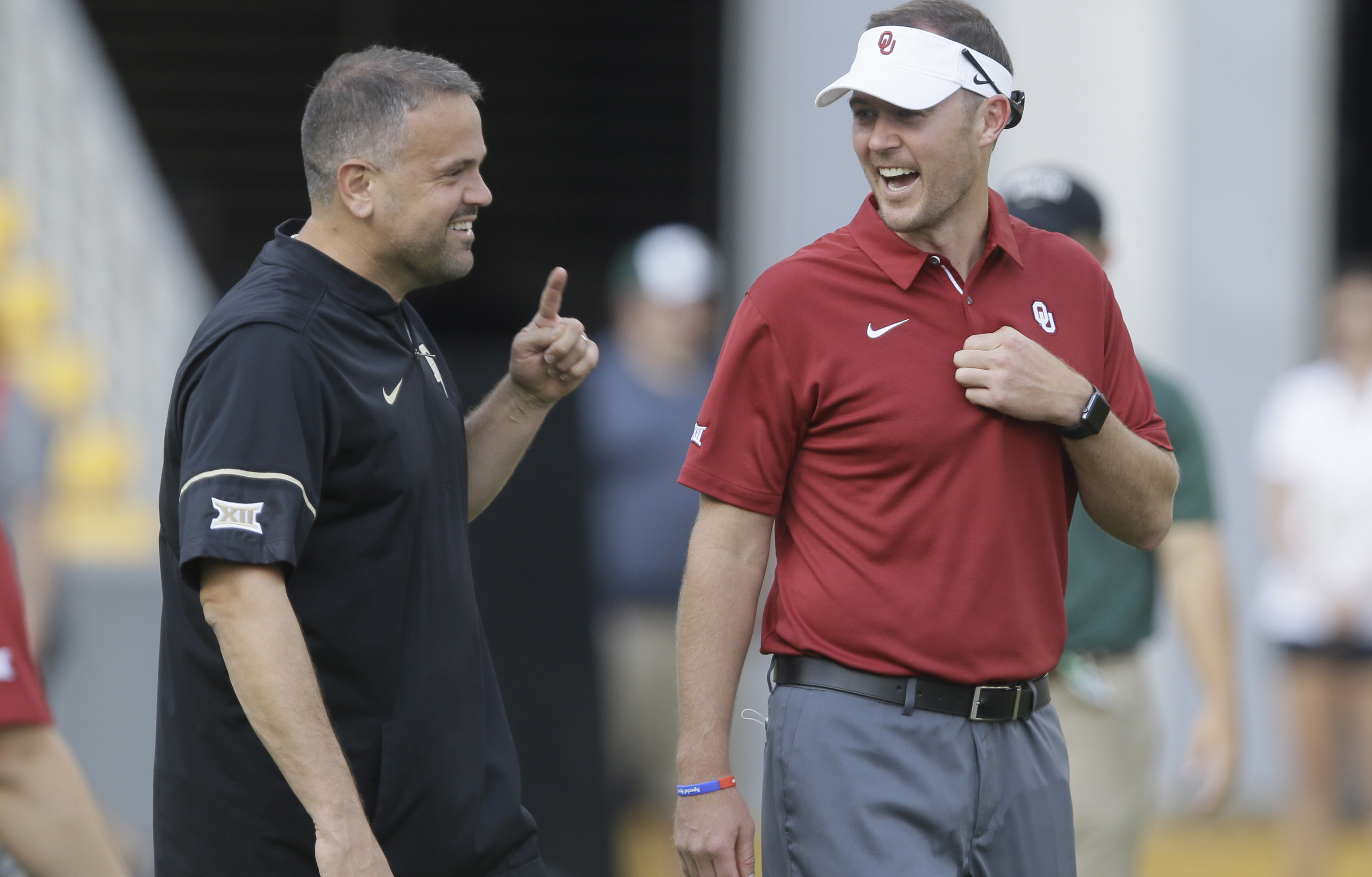 Oklahoma head coach Lincoln Riley, right, and Baylor head coach Matt Rhule visit on the field before an NCAA college football game in Waco, Texas, Saturday, Sept. 23, 2017. (AP Photo/LM Otero)