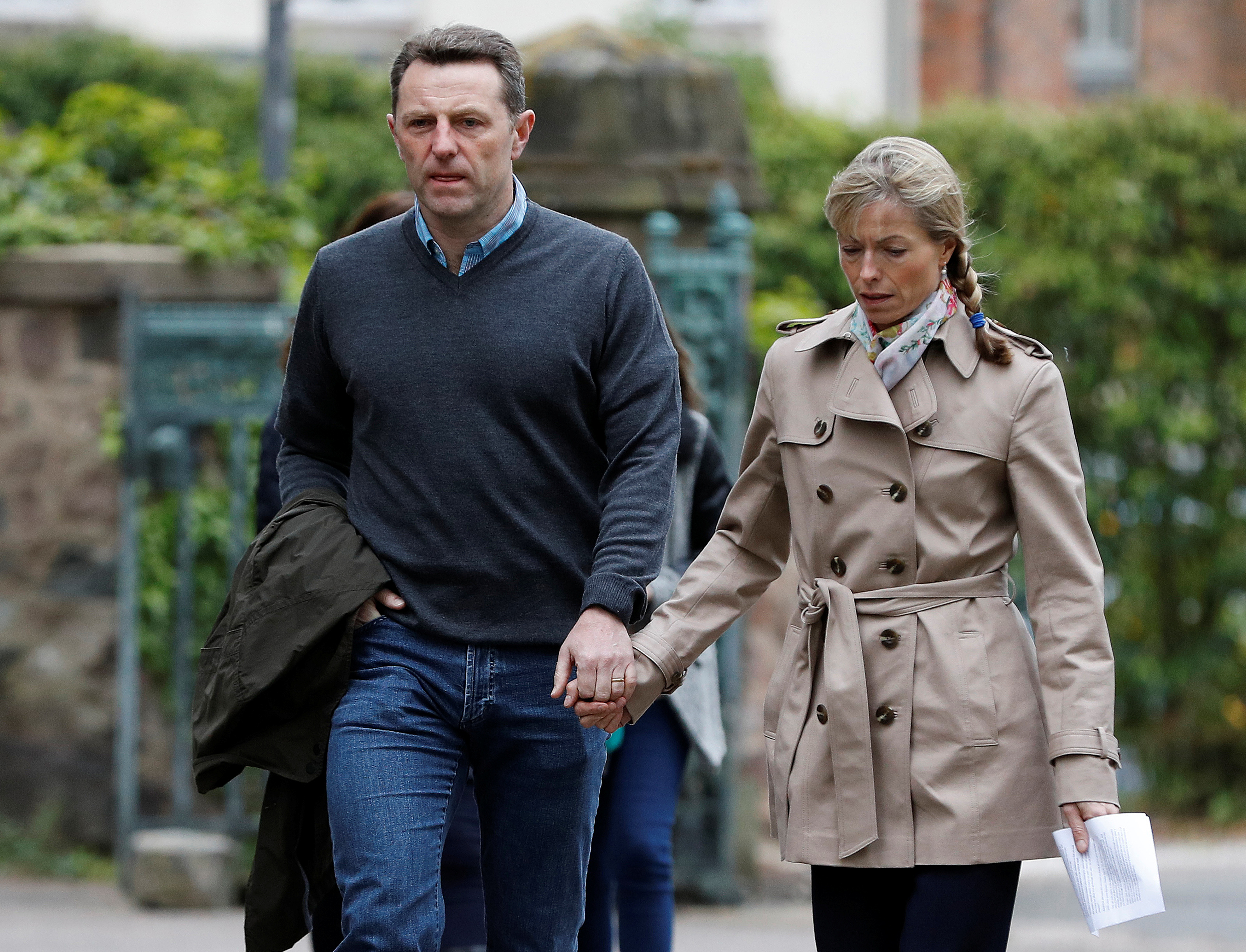 Kate and Gerry McCann arrive for a service to mark the 10th anniversary of the disappearance of their daughter Madeleine, at St Mary and St John church in Rothley, Britain May 3, 2017. REUTERS/Darren Staples