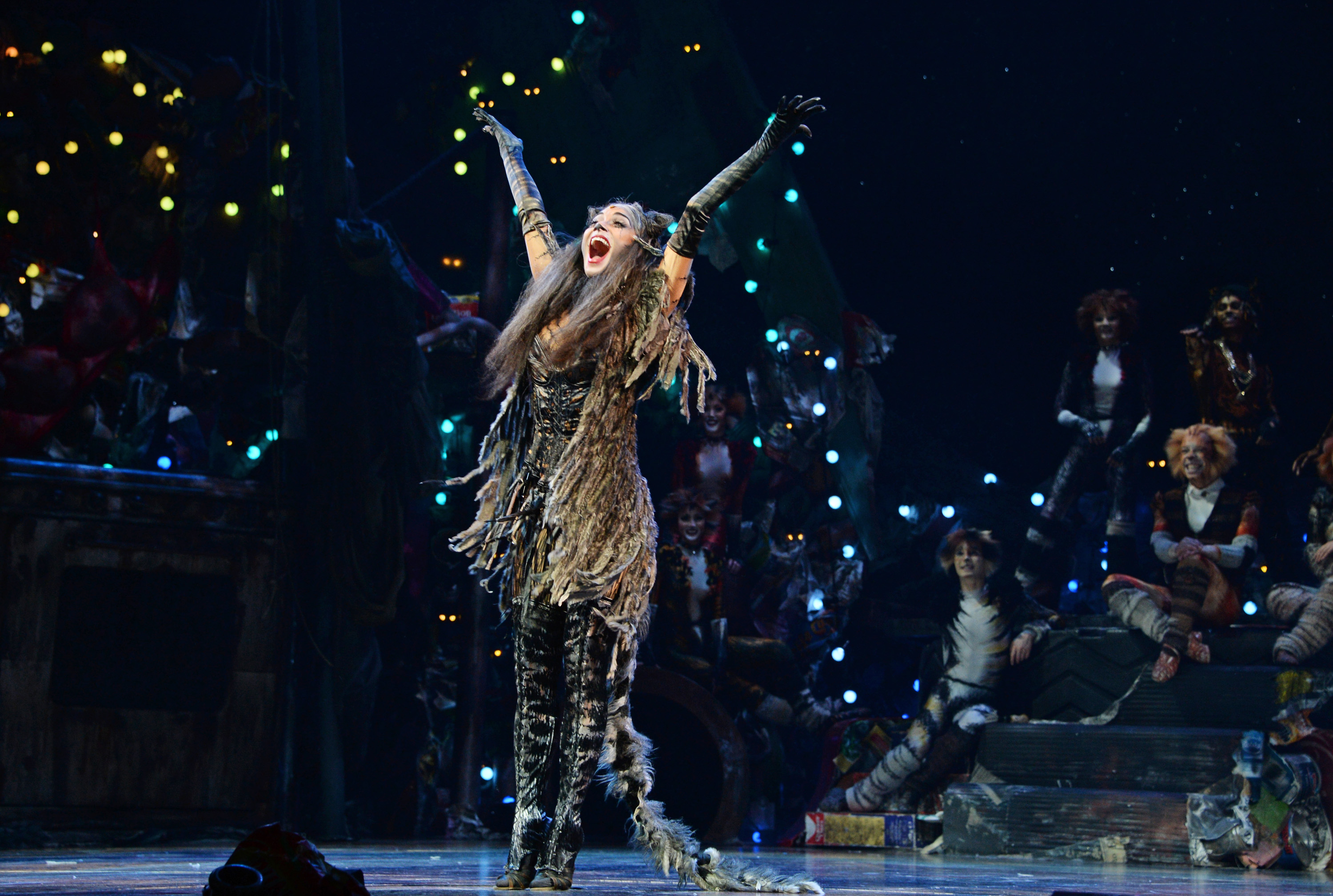 """LONDON, ENGLAND - DECEMBER 11:  Nicole Scherzinger bows at the curtain call during the press night performance of """"Cats"""" as Nicole Scherzinger joins the cast at the London Palladium on December 11, 2014 in London, England.  (Photo by David M. Benett/Getty Images)"""