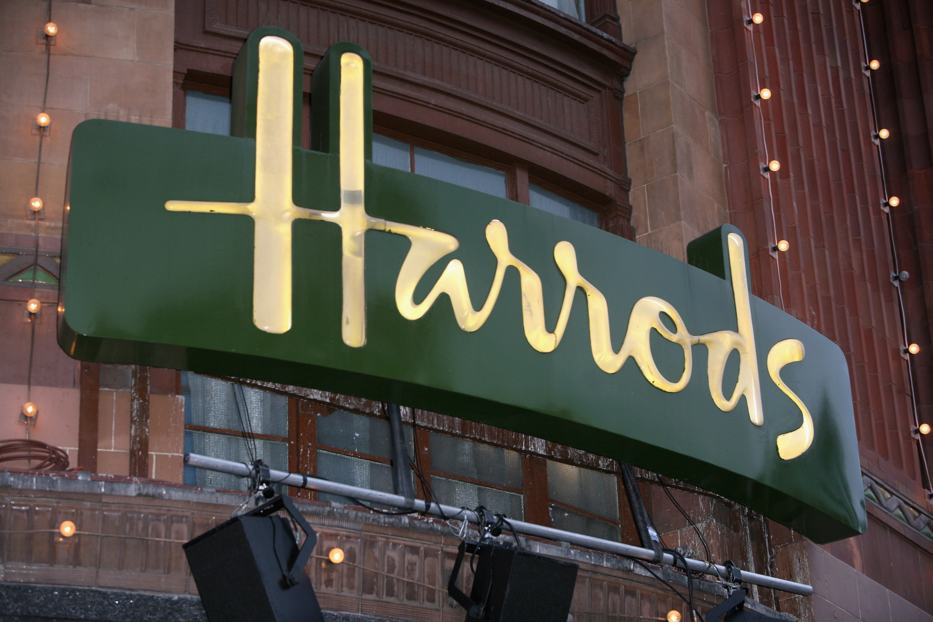 LONDON - NOVEMBER 01:  The Harrods sign is illuminated during the Christmas Parade to celebrate the opening of Santas Grotto at Harrods on November 1, 2008 in London, England.  (Photo by Tim Whitby/Getty Images)