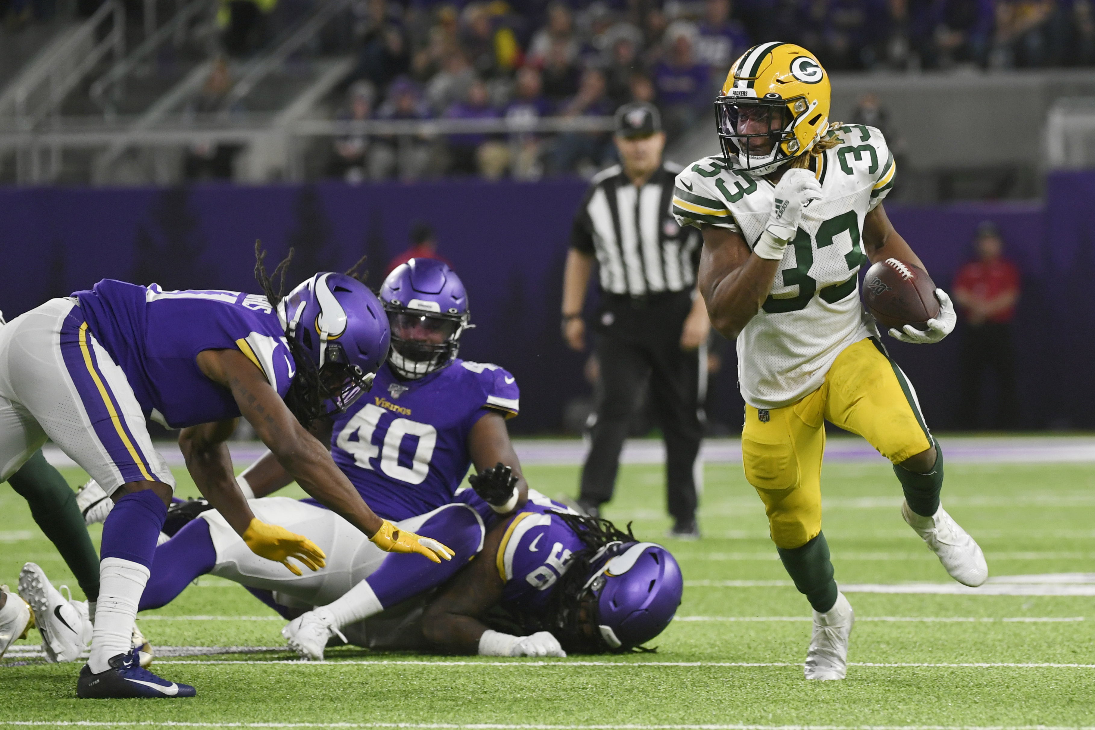 Running back Aaron Jones had a big night as the Packers clinched the division title. (AP Photo/Craig Lassig)