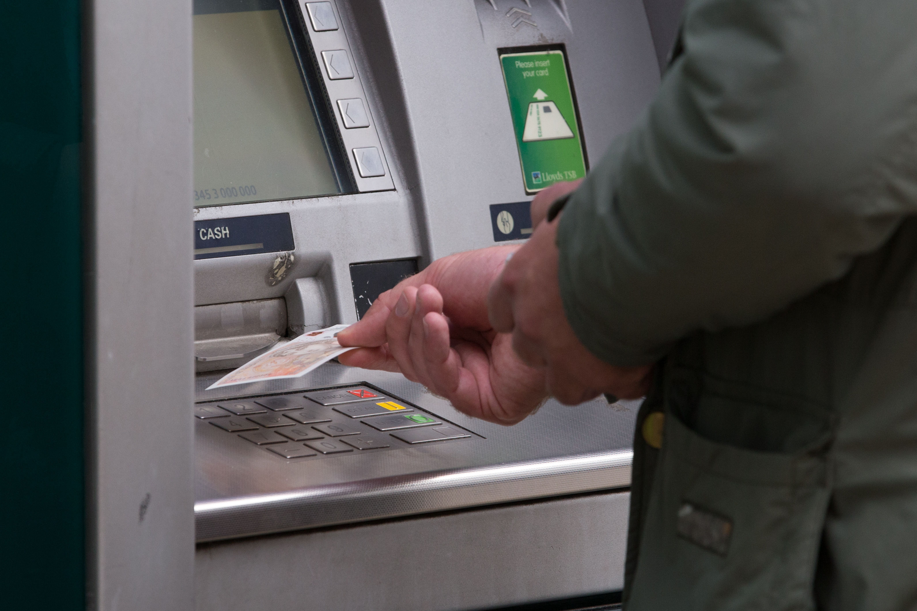 EMBARGOED TO 0001 MONDAY JULY 22 File photo dated 14/09/17 of a man withdrawing money from an ATM. The volume of cash withdrawals from ATMs declined year-on-year across the UK's nations and regions in early 2019, according to cash machine network Link.