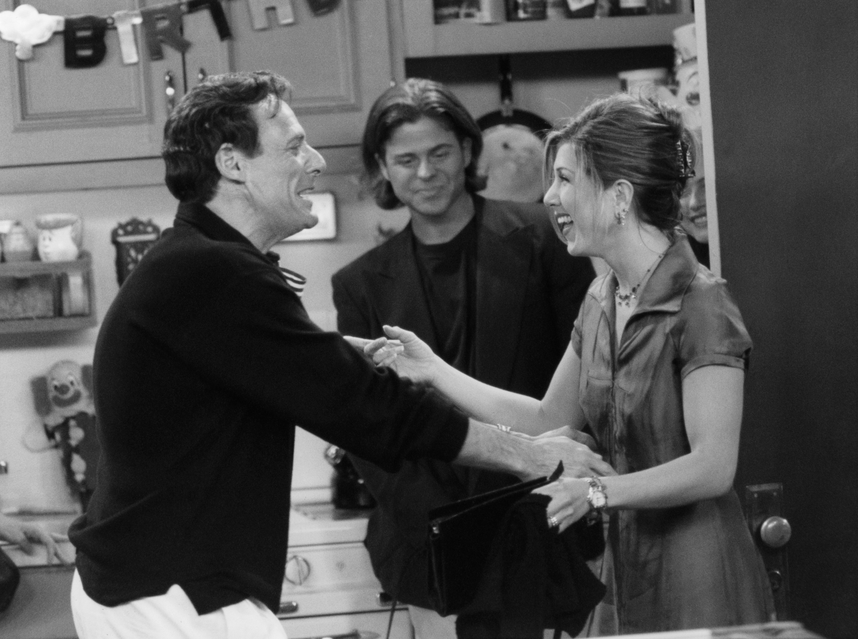 """FRIENDS -- """"The One with the Two Parties"""" Episode 22 -- Air Date 05/02/1996 -- Pictured: (l-r) Ron Leibman as Dr. Leonard Green, Jennifer Aniston as Rachel Green  (Photo by NBCU Photo Bank/NBCUniversal via Getty Images via Getty Images)"""