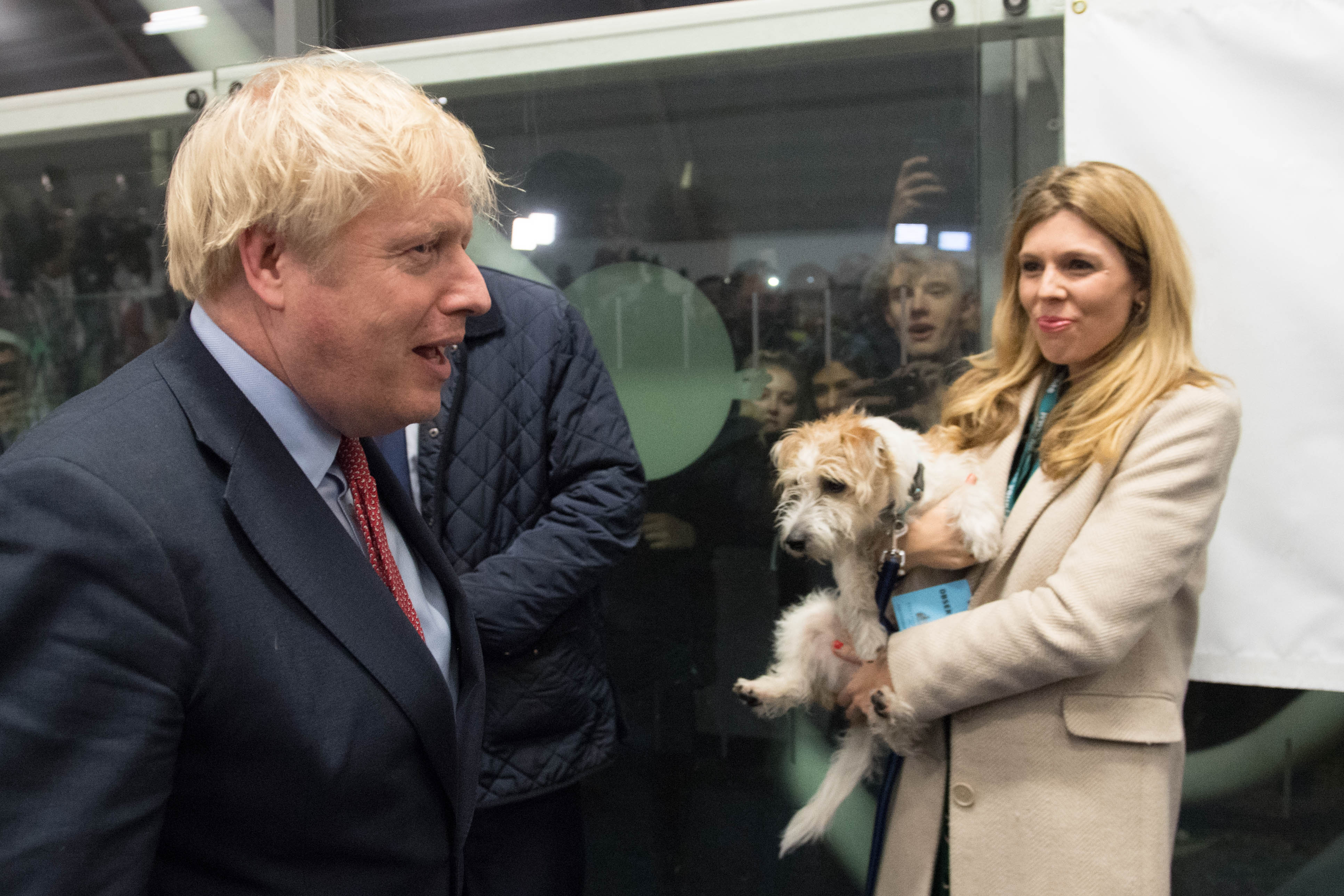 Prime Minister Boris Johnson with partner Carrie Symonds and dog Dilyn at the count for the Uxbridge & Ruislip South constituency in the 2019 General Election.