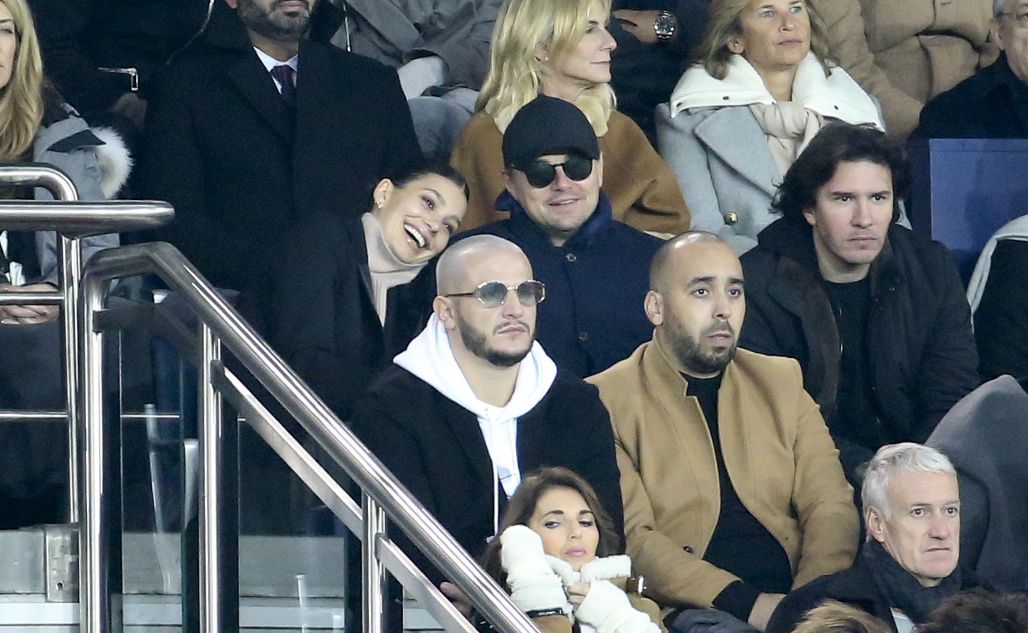 Leonardo DiCaprio and his girlfriend Camila Morrone, below DJ Snake attend the UEFA Champions League Group C match between Paris Saint-Germain (PSG) and Liverpool FC at Parc des Princes stadium on November 28, 2018 in Paris, France. (Photo by Jean Catuffe/Getty Images)
