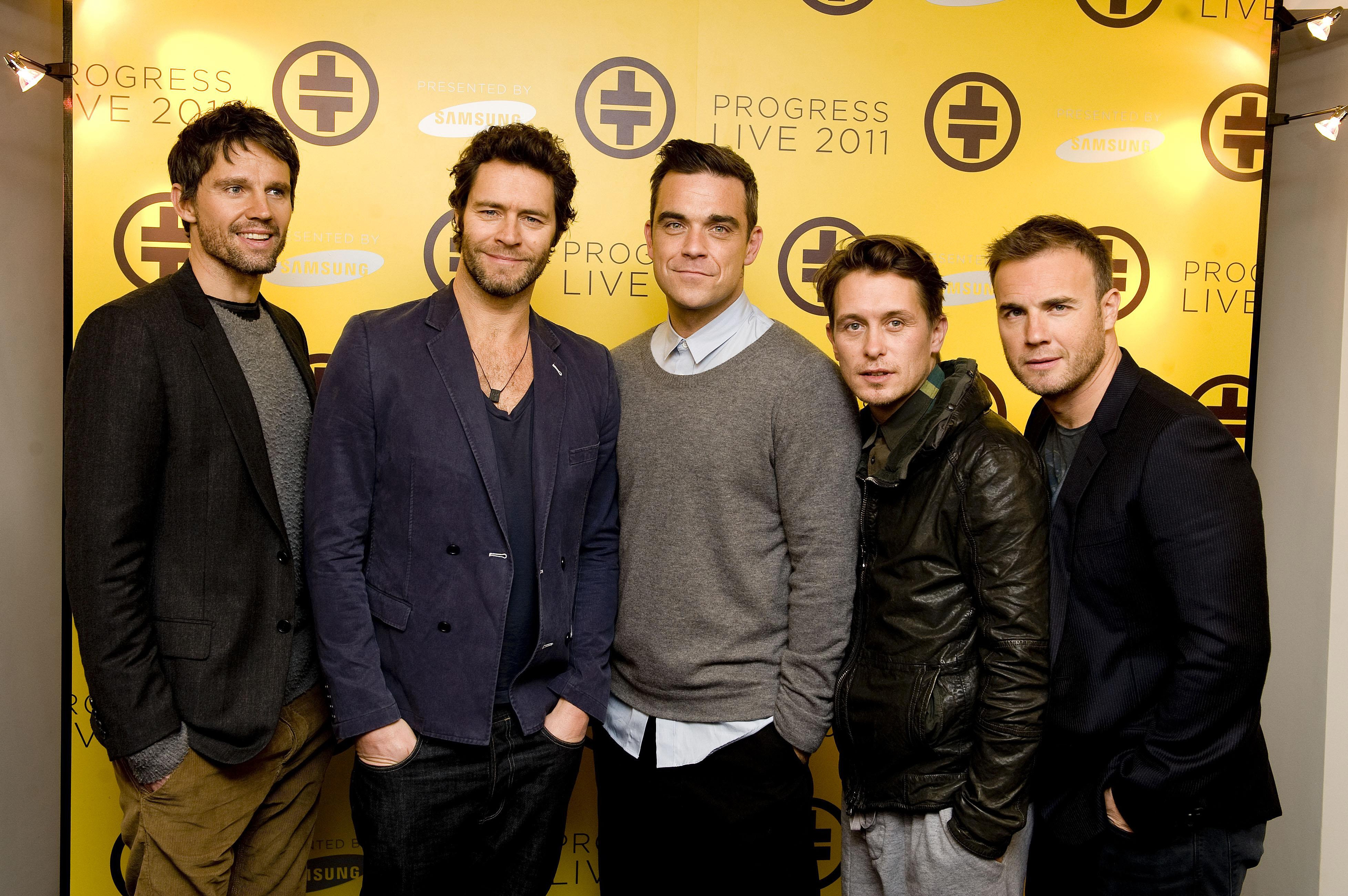 (From the left) Jason Orange, Howard Donald, Robbie Williams, Mark Owen and Gary Barlow of Take That during a photocall in London, where they announced their first tour as a complete group in 16 years.