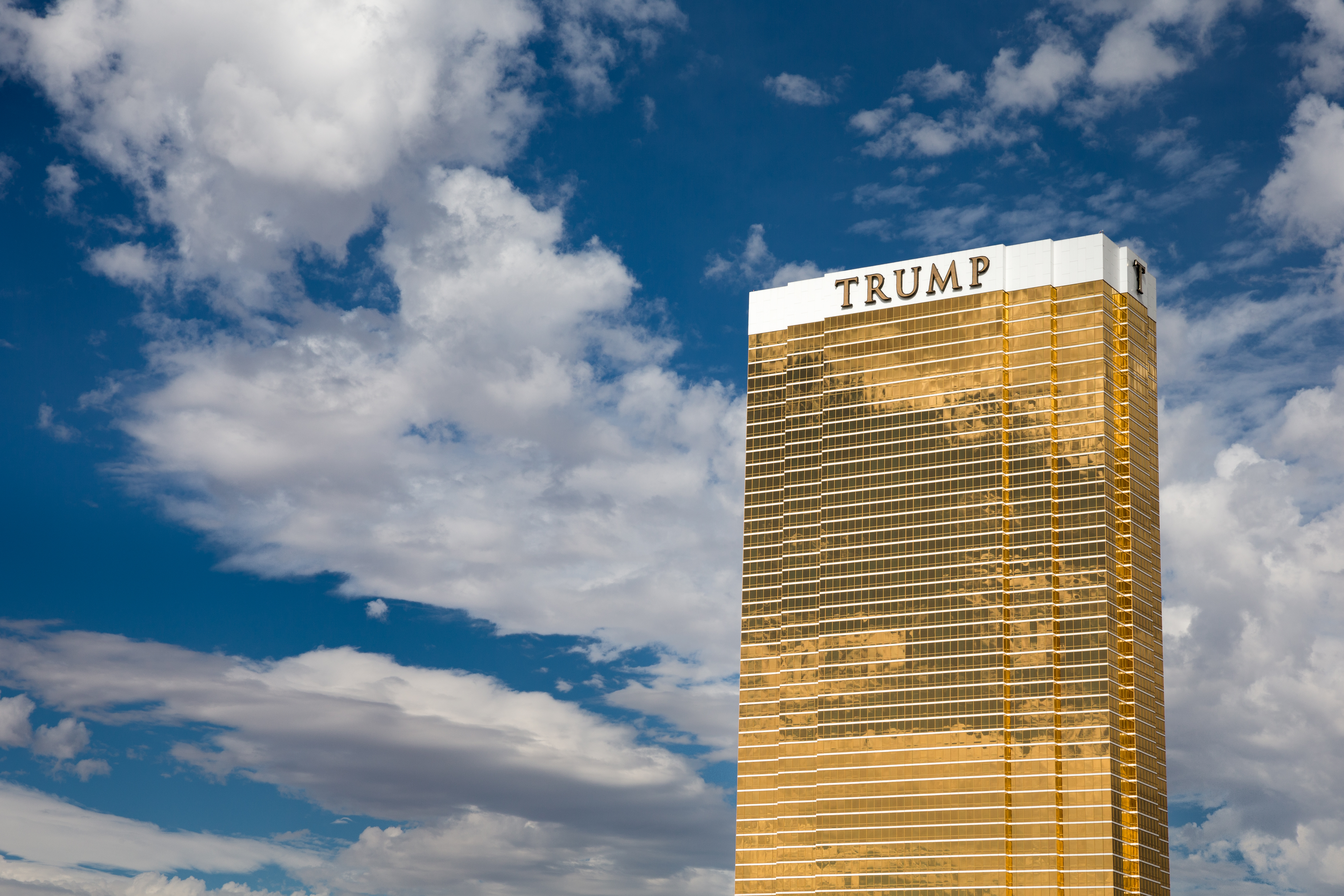Las Vegas, USA - October 28, 2016:  Trump International Hotel in Las Vegas, NV set against a dramatic blue sky.  Named for US real estate developer and politician Donald Trump, the 64-story luxury property's exterior windows are gilded with 24-carat gold.