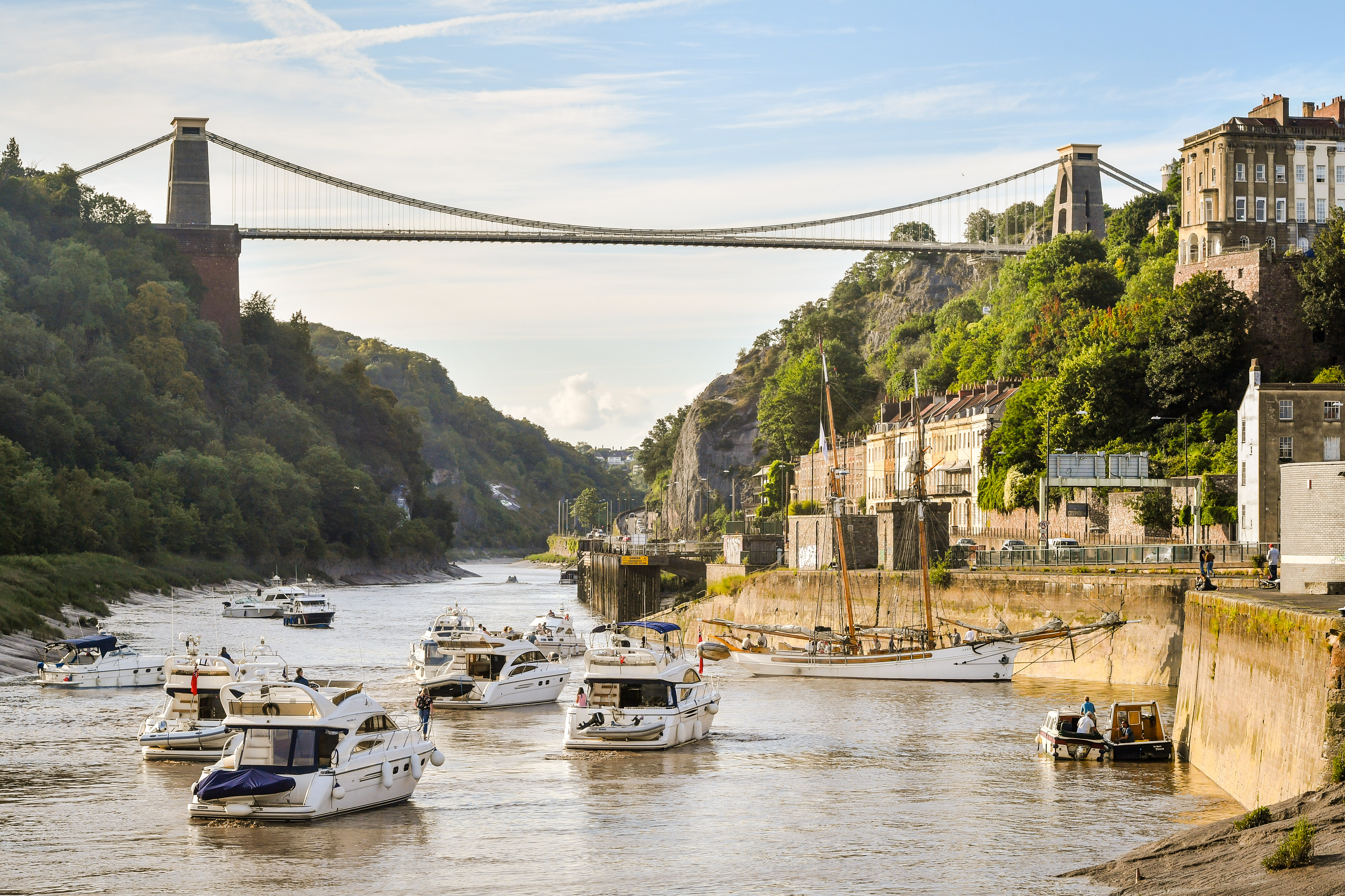 Boats make their way through the Avon Gorge and underneath Clifton Suspension Bridge as they head to Bristol harbour for the Bristol Harbour Festival, where hundreds of vessels from tall ships to dinghies will gather in the city centre floating harbour. (Photo by Ben Birchall/PA Images via Getty Images)