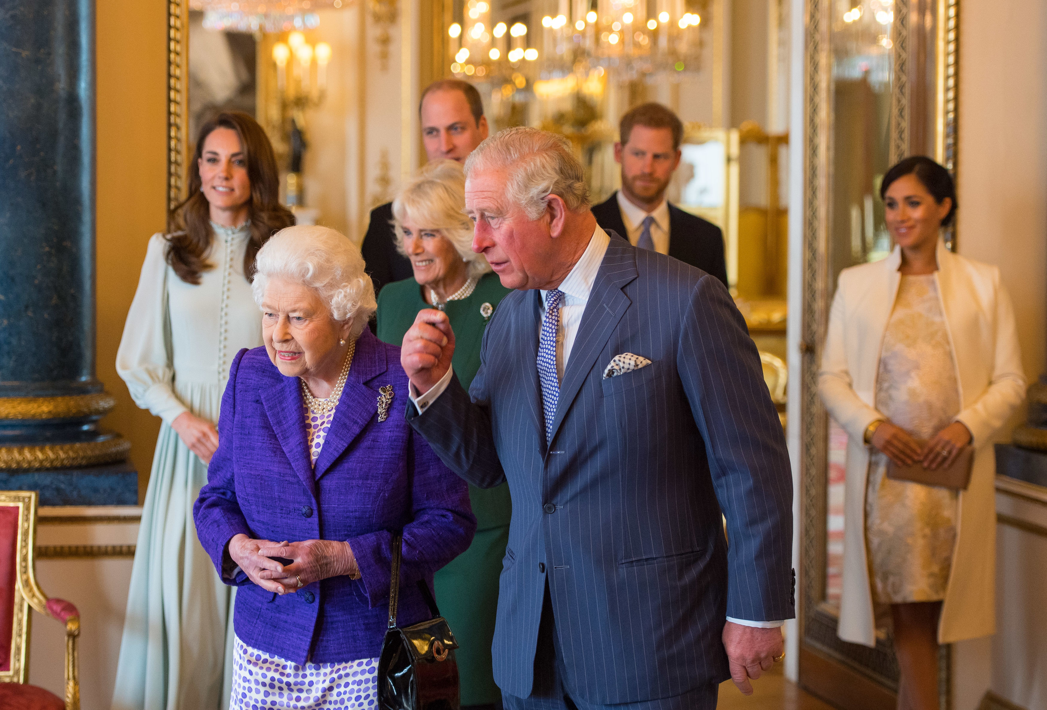 File photo dated 05/03/19 of the Duke and Duchess of Sussex joining Queen Elizabeth II and the Prince of Wales, followed by the Duke and Duchess of Cambridge and the Duchess of Cornwall, at a reception at Buckingham Palace in London to mark the fiftieth anniversary of the investiture of the Prince of Wales, as the PA news agency looks back on the royal couple's year.