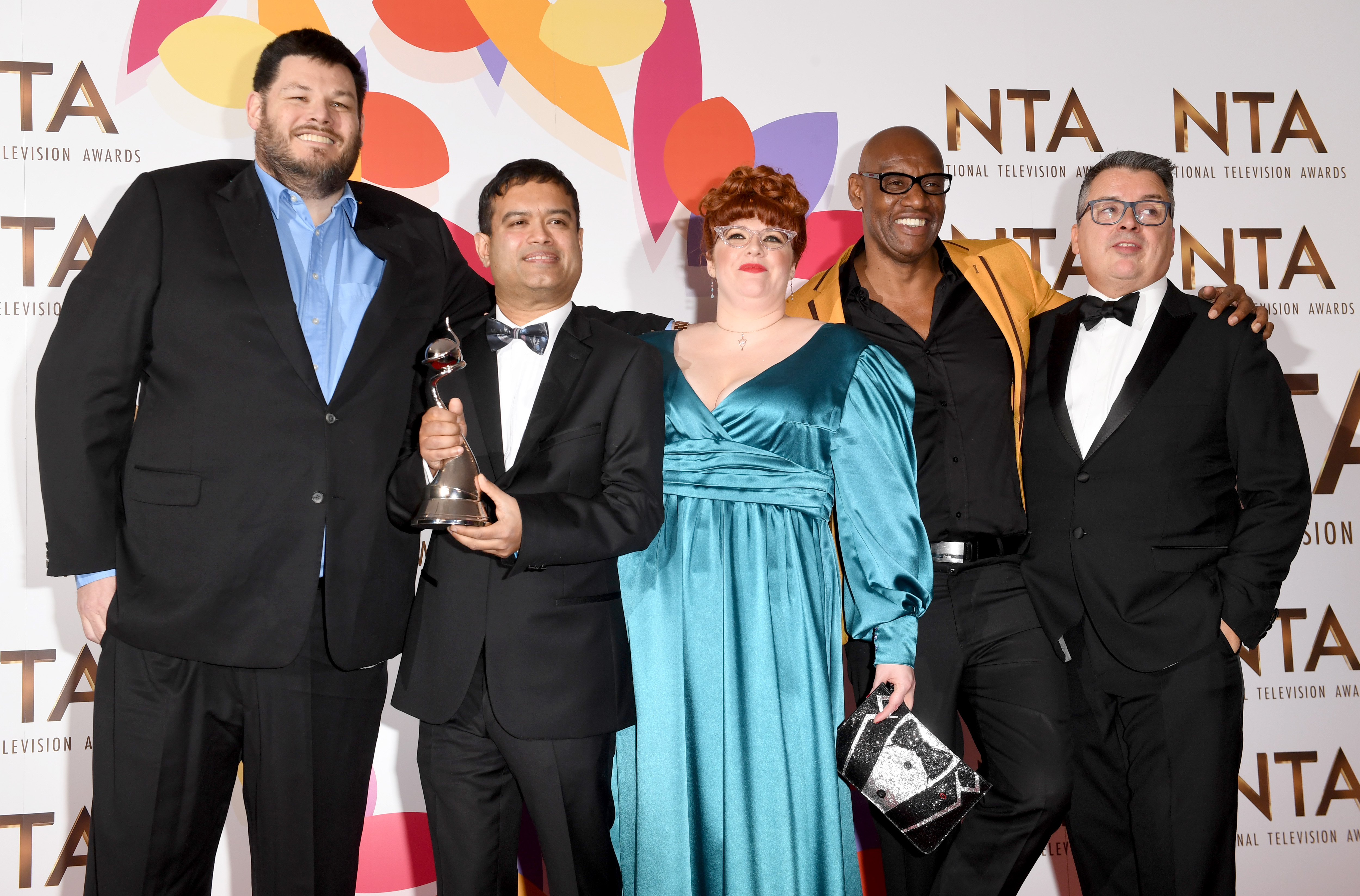 "LONDON, ENGLAND - JANUARY 22:  Mark Labbett, Paul Sinha, Jenny Ryan, Shaun Wallace and guest with the award for Quiz Show for ""The Chase"" during the National Television Awards held at The O2 Arena on January 22, 2019 in London, England. (Photo by Stuart C. Wilson/Getty Images)"