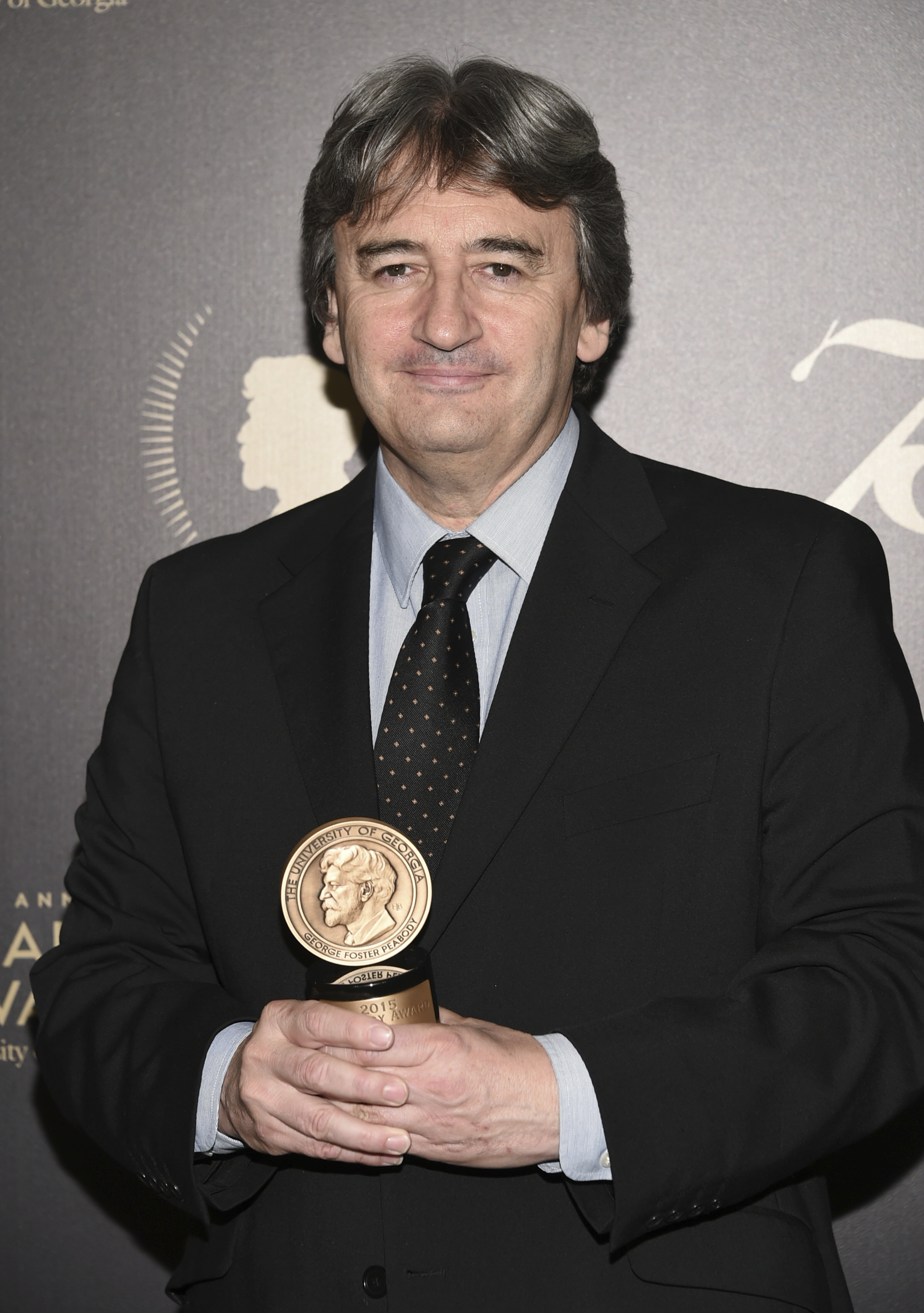 The BBC's Fergal Keane poses with his award at the 75th Annual Peabody Awards Ceremony at Cipriani Wall Street on Saturday, May 21, 2016, in New York. (Photo by Evan Agostini/Invision/AP)