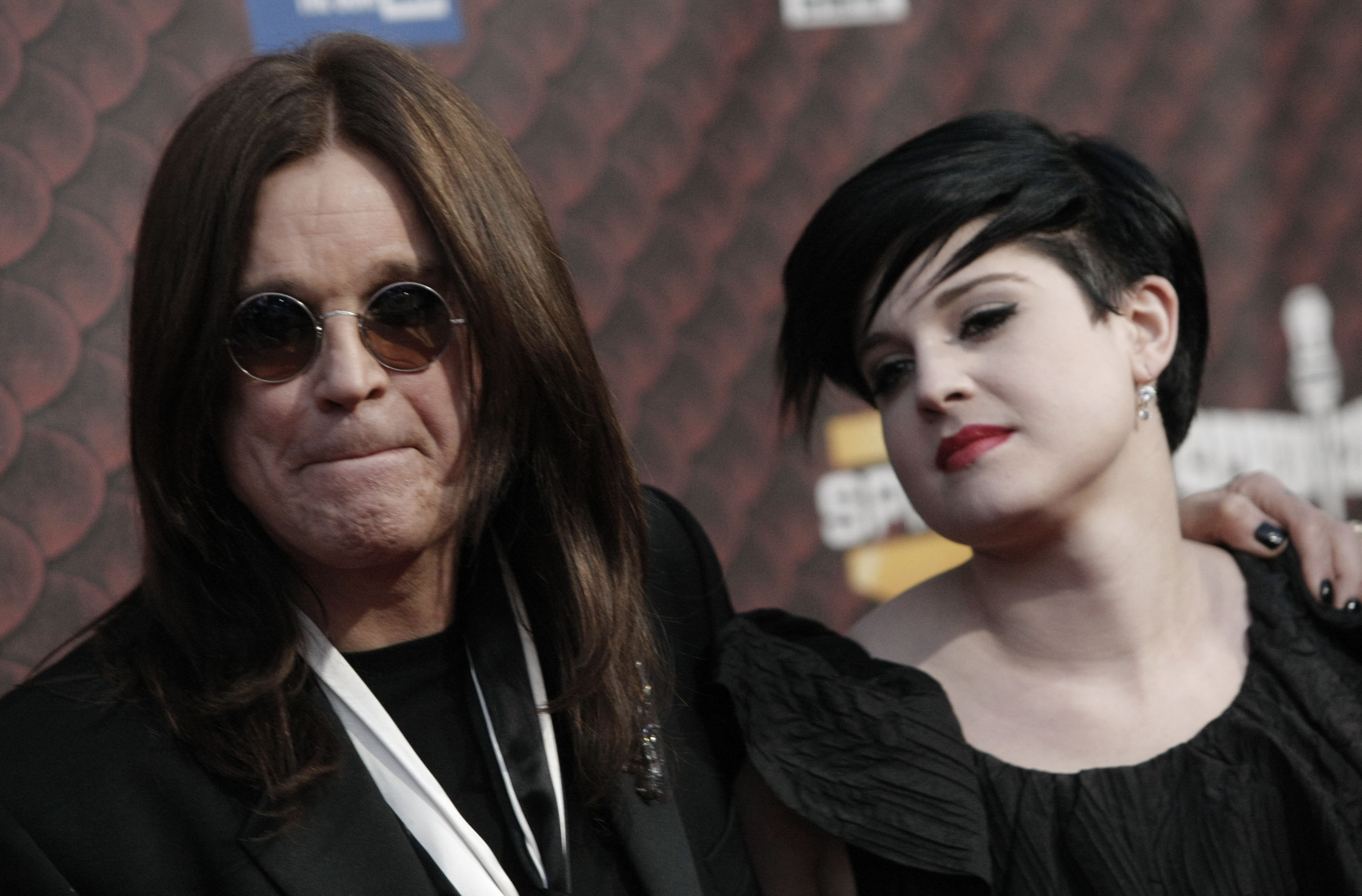 Ozzy Osbourne, left, and daughter Kelly Osbourne arrive at the Scream Awards on Saturday Oct. 18, 2008 in Los Angeles. (AP Photo/Dan Steinberg)