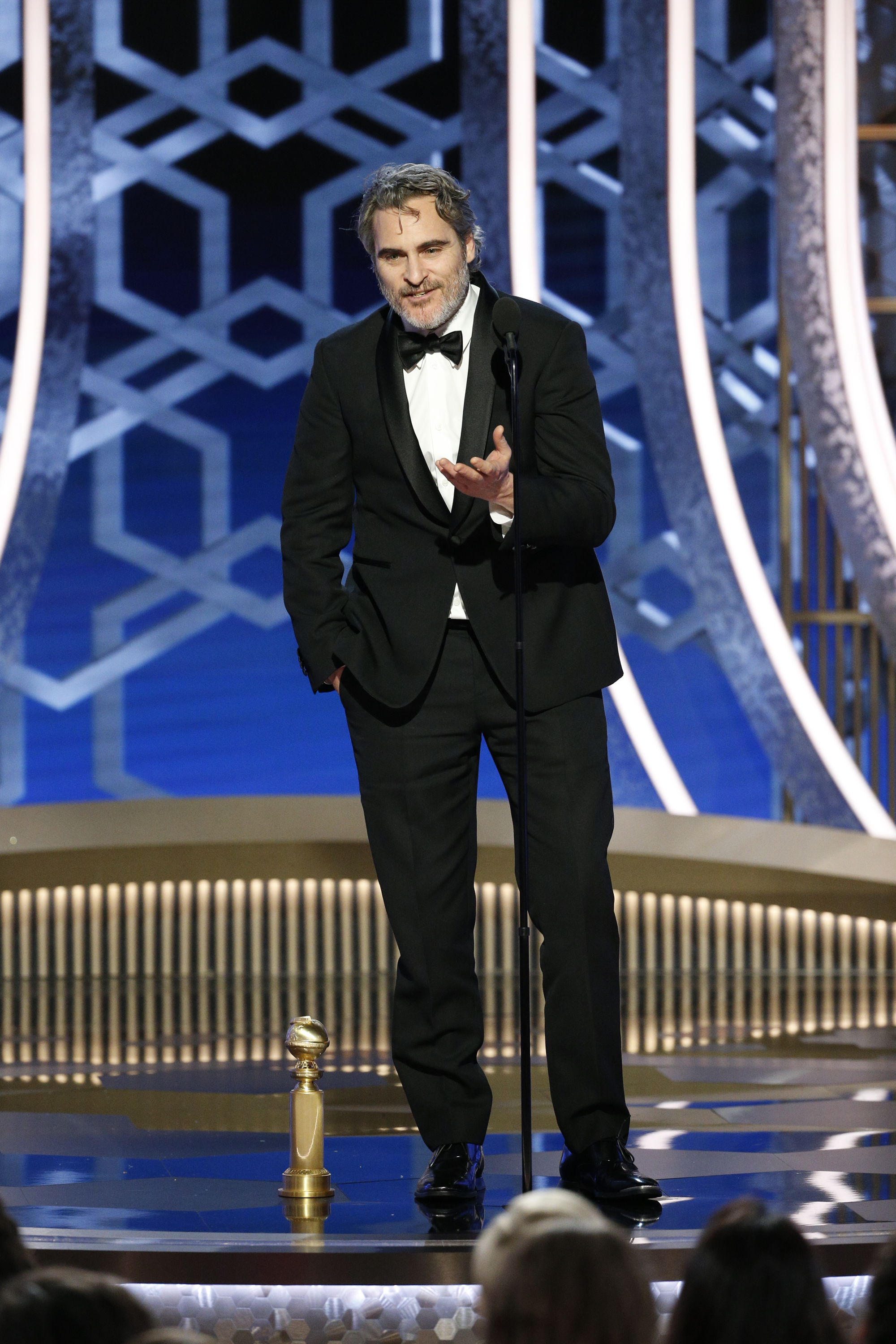"""BEVERLY HILLS, CALIFORNIA - JANUARY 05: In this handout photo provided by NBCUniversal Media, LLC,  Joaquin Phoenix accepts the award for BEST PERFORMANCE BY AN ACTOR IN A MOTION PICTURE - DRAMA for """"Joker"""" onstage during the 77th Annual Golden Globe Awards at The Beverly Hilton Hotel on January 5, 2020 in Beverly Hills, California. (Photo by Paul Drinkwater/NBCUniversal Media, LLC via Getty Images)"""