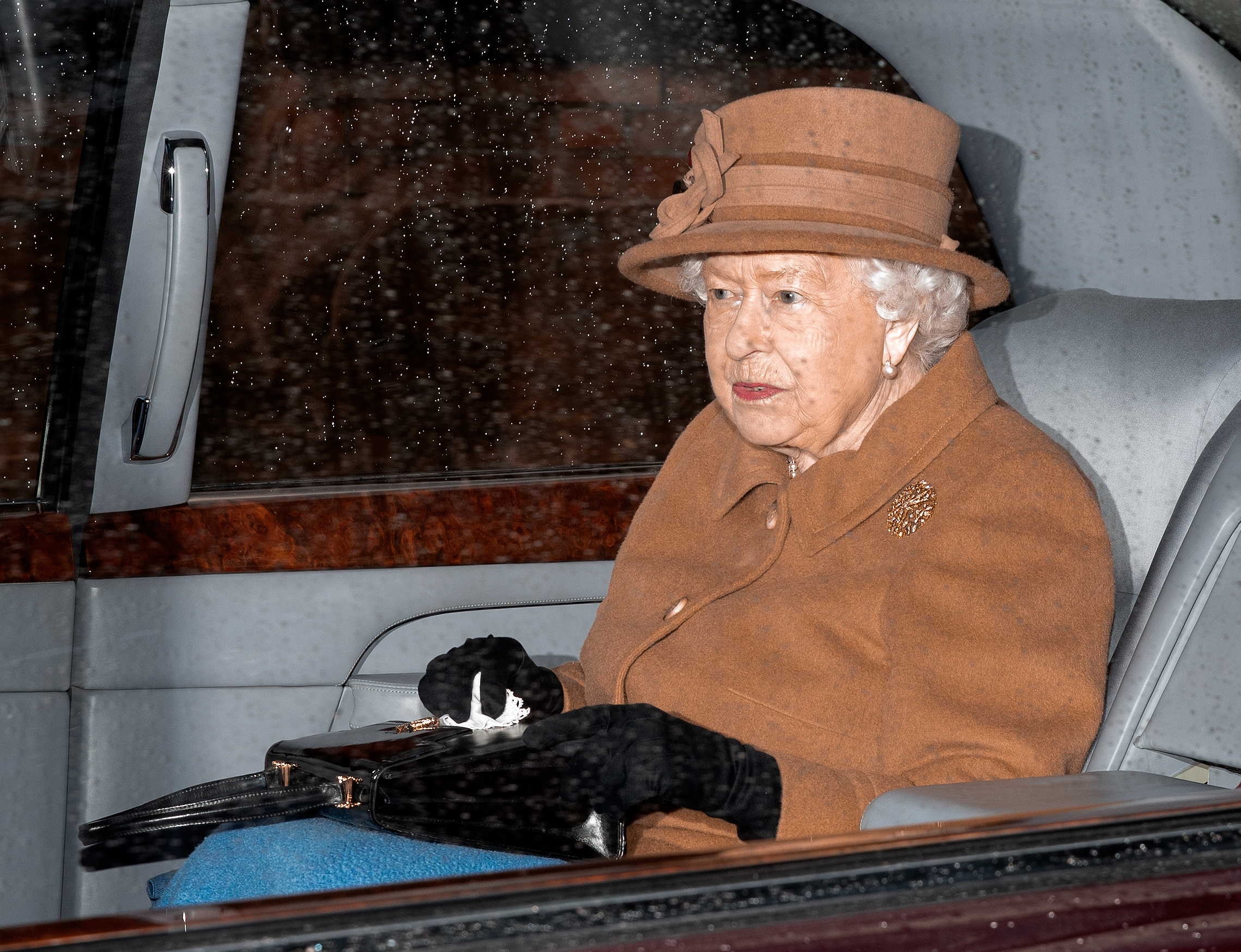 KING'S LYNN, UNITED KINGDOM - JANUARY 12: (EMBARGOED FOR PUBLICATION IN UK NEWSPAPERS UNTIL 24 HOURS AFTER CREATE DATE AND TIME) Queen Elizabeth II departs in her Bentley car after attending Sunday service at the Church of St Mary Magdalene on the Sandringham estate on January 12, 2020 in King's Lynn, England. (Photo by Max Mumby/Indigo/Getty Images)