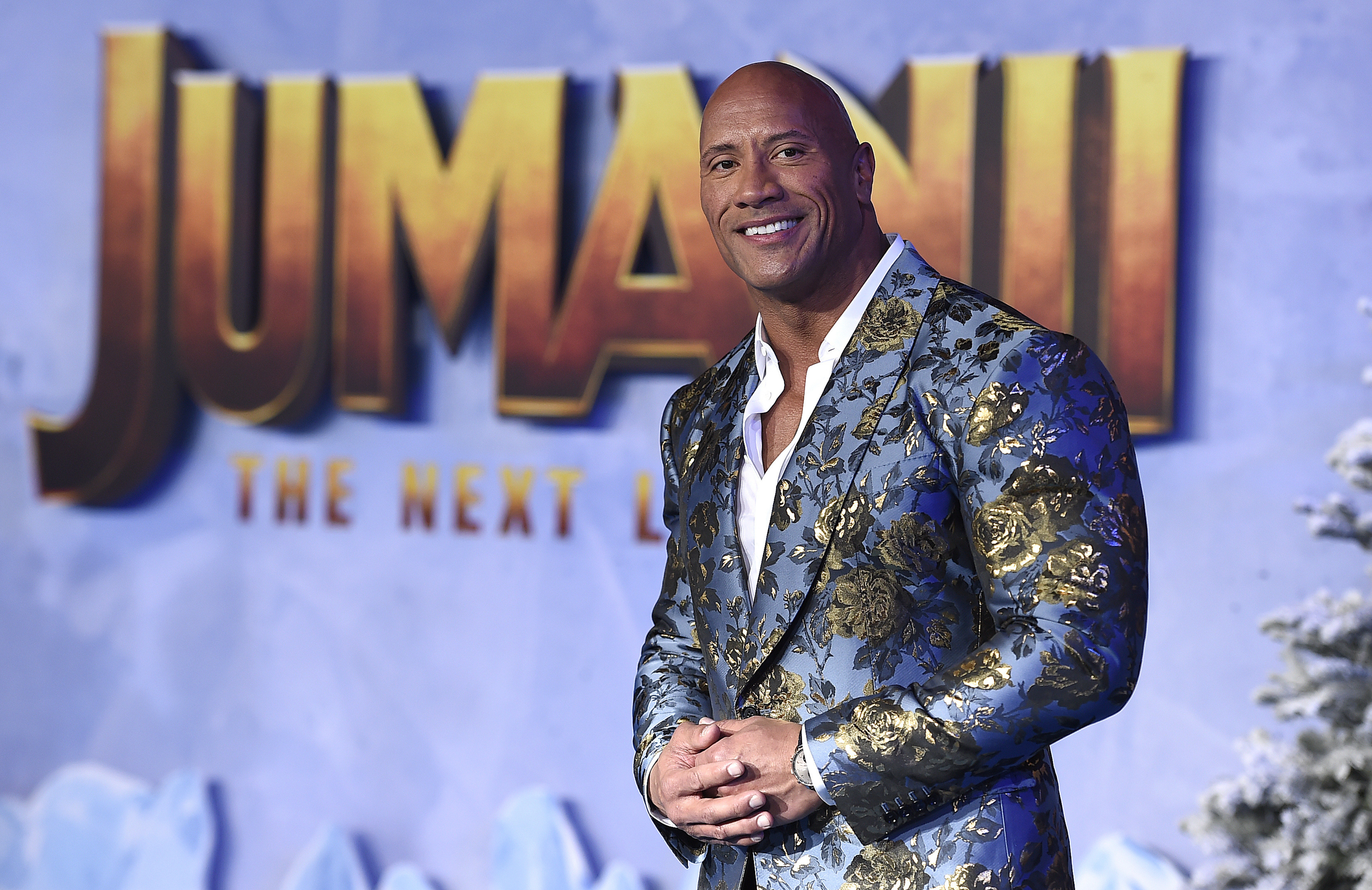 """Cast member Dwayne Johnson poses for photographers at the Los Angeles premiere of """"Jumanji: The Next Level"""" at the TCL Chinese Theatre on Monday, Dec. 9, 2019. (Photo by Jordan Strauss/Invision/AP)"""