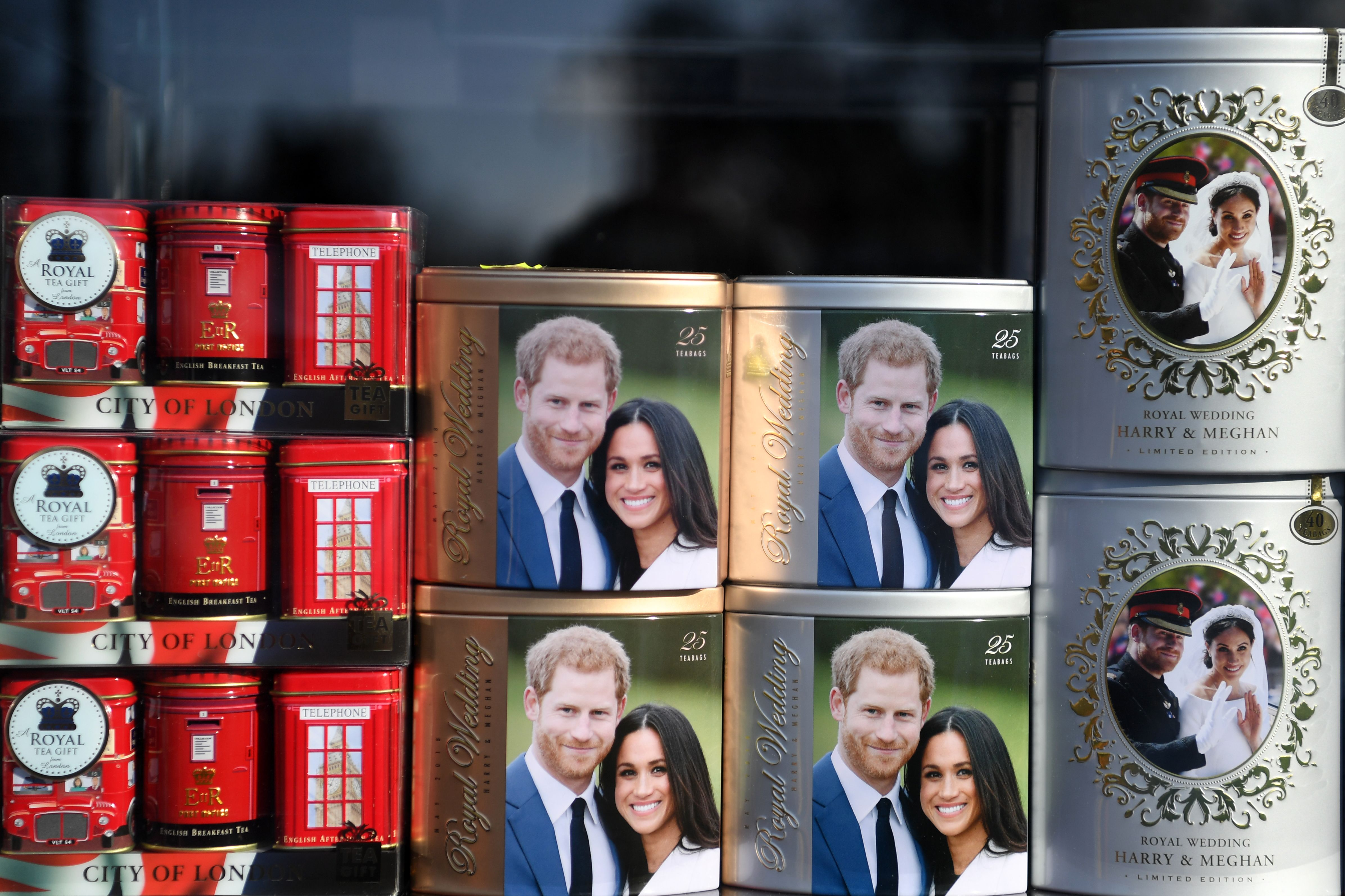 Royal memorabilia featuring Britain's Prince Harry, Duke of Sussex, and Meghan, Duchess of Sussex is displayed in a souvenir shop in Windsor, west of London on January 9, 2020. - Britain's Prince Harry and his wife Meghan stunned the British monarchy on Wednesday by quitting as front-line members -- reportedly without first consulting Queen Elizabeth II. In a shock announcement, the couple said they would spend time in North America and rip up long-established relations with the press. Media reports said the Duke and Duchess of Sussex made their bombshell statement without notifying either Harry's grandmother the monarch, or his father Prince Charles. (Photo by DANIEL LEAL-OLIVAS / AFP) (Photo by DANIEL LEAL-OLIVAS/AFP via Getty Images)
