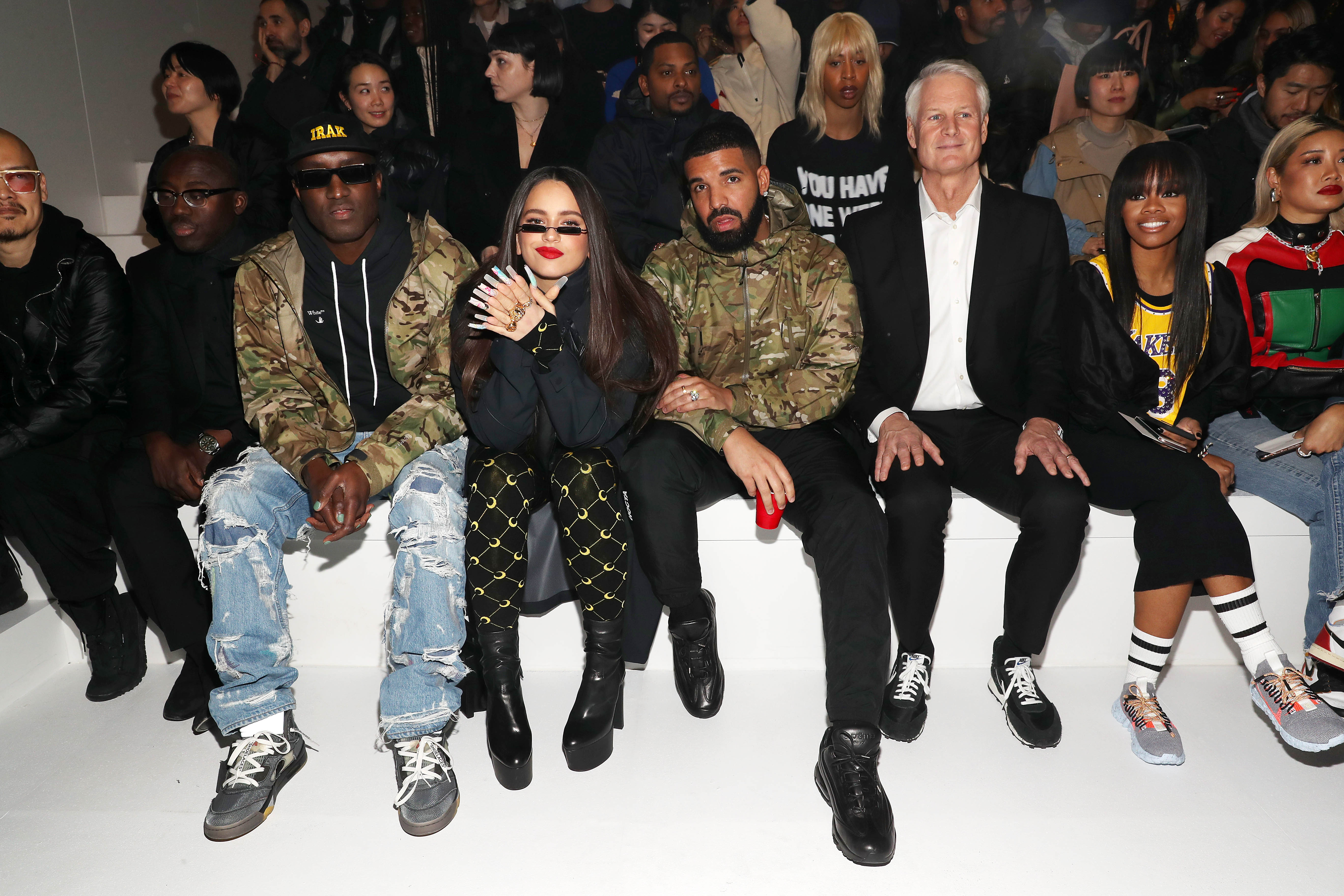 NEW YORK, NEW YORK - FEBRUARY 05:(L - R) Edward Enninful, Virgil Abloh, Rosalia, Drake, John Donahoe and Gabby Douglas attend the 2020 Tokyo Olympic collection fashion show at The Shed on February 05, 2020 in New York City. (Photo by Bennett Raglin/Getty Images)