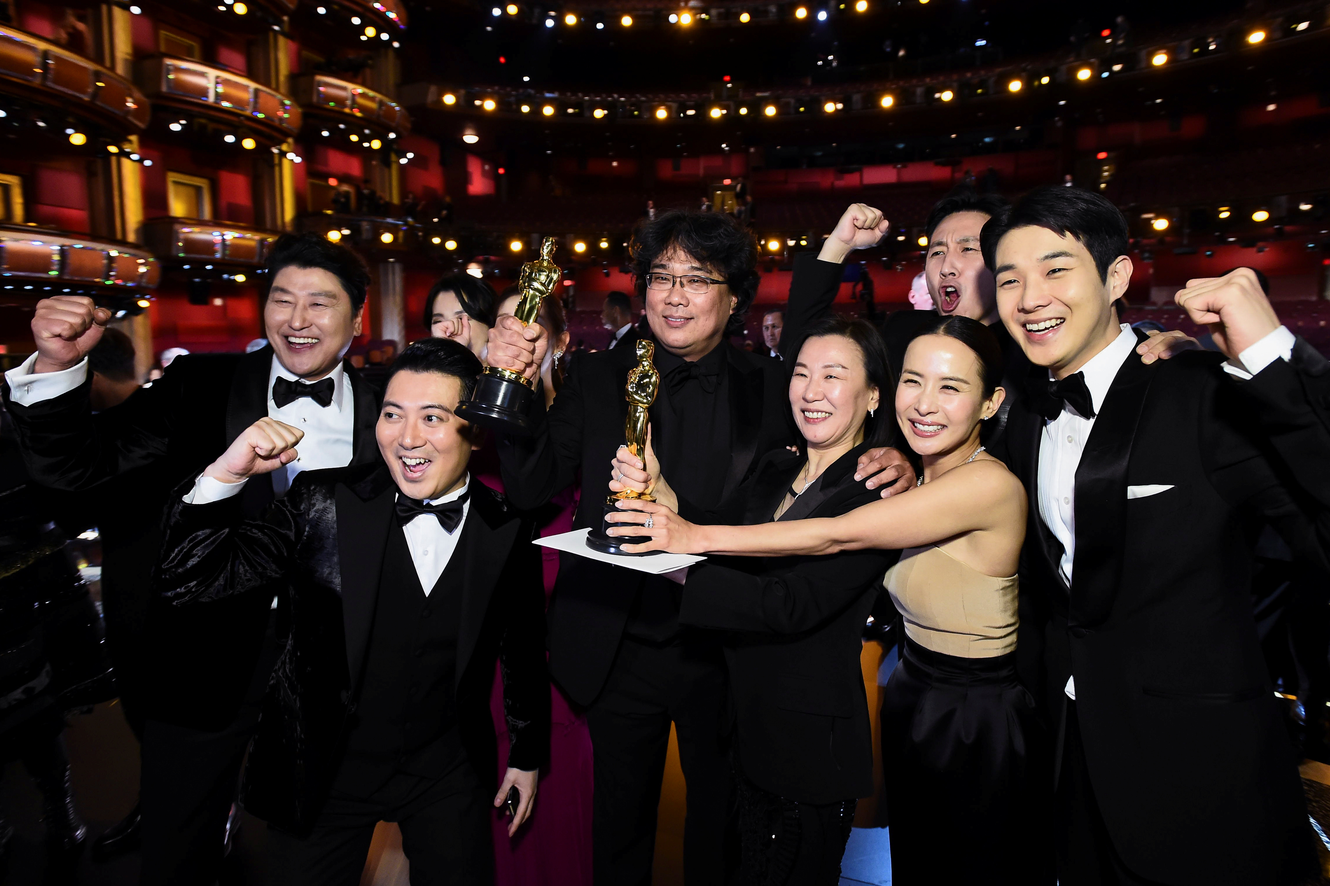 """Bong Joon Ho and the cast of """"Parasite"""" pose at the 92nd Academy Awards in Hollywood, Los Angeles, California, U.S., February 9, 2020. Matt Petit/A.M.P.A.S./Handout via REUTERS ATTENTION EDITORS. THIS IMAGE HAS BEEN SUPPLIED BY A THIRD PARTY. NO MARKETING OR ADVERTISING IS PERMITTED WITHOUT THE PRIOR CONSENT OF A.M.P.A.S AND MUST BE DISTRIBUTED AS SUCH. MANDATORY CREDIT."""