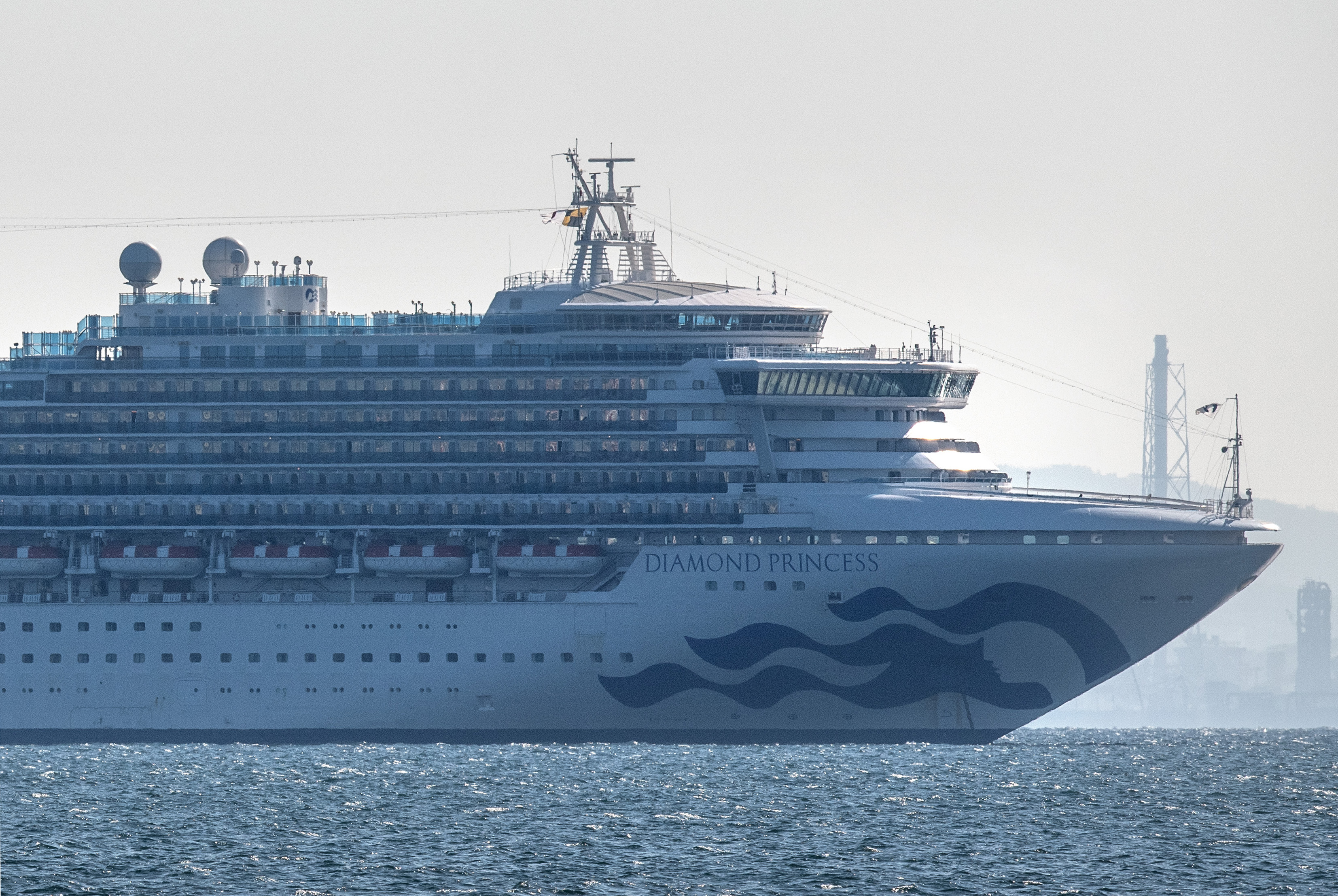 YOKOHAMA, JAPAN - FEBRUARY 05: The Diamond Princess cruise ship with around 3,700 people on board sits anchored in quarantine off the port of Yokohama after a number of passengers were confirmed to be infected with coronavirus, on February 5, 2020 in Yokohama, Japan. 10 passengers are now believed to be infected with the coronavirus as Japanese authorities work to screen all people on board. The new cases bring the total number of confirmed infections to 33 in Japan. (Photo by Carl Court/Getty Images)