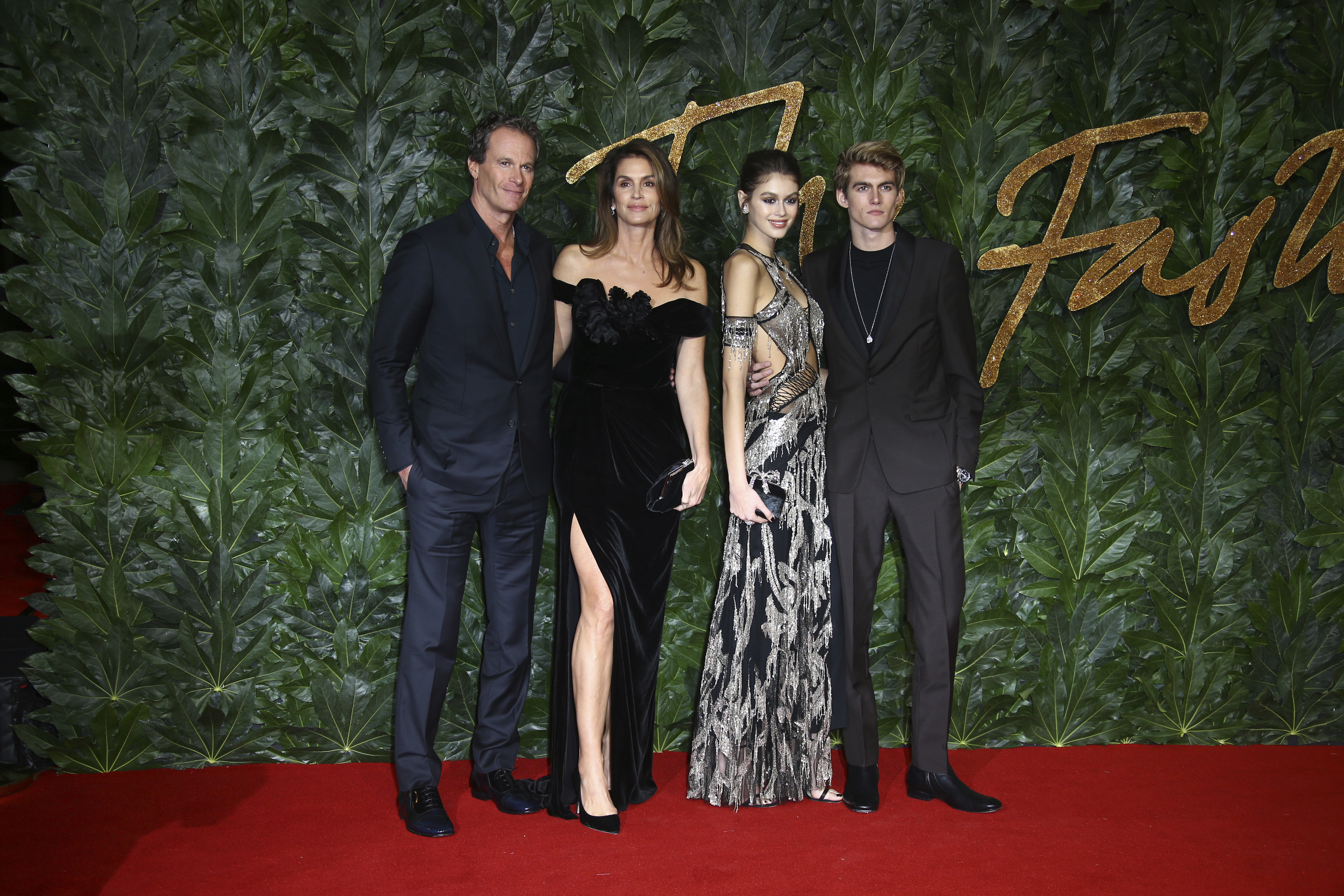 Businessman Rande Gerber, from left, models Cindy Crawford, Kaia Gerber and Presley Walker Gerber pose for photographers upon arrival at the The Fashion Awards 2018 in central London, Monday, Dec. 10, 2018. (Photo by Joel C Ryan/Invision/AP)