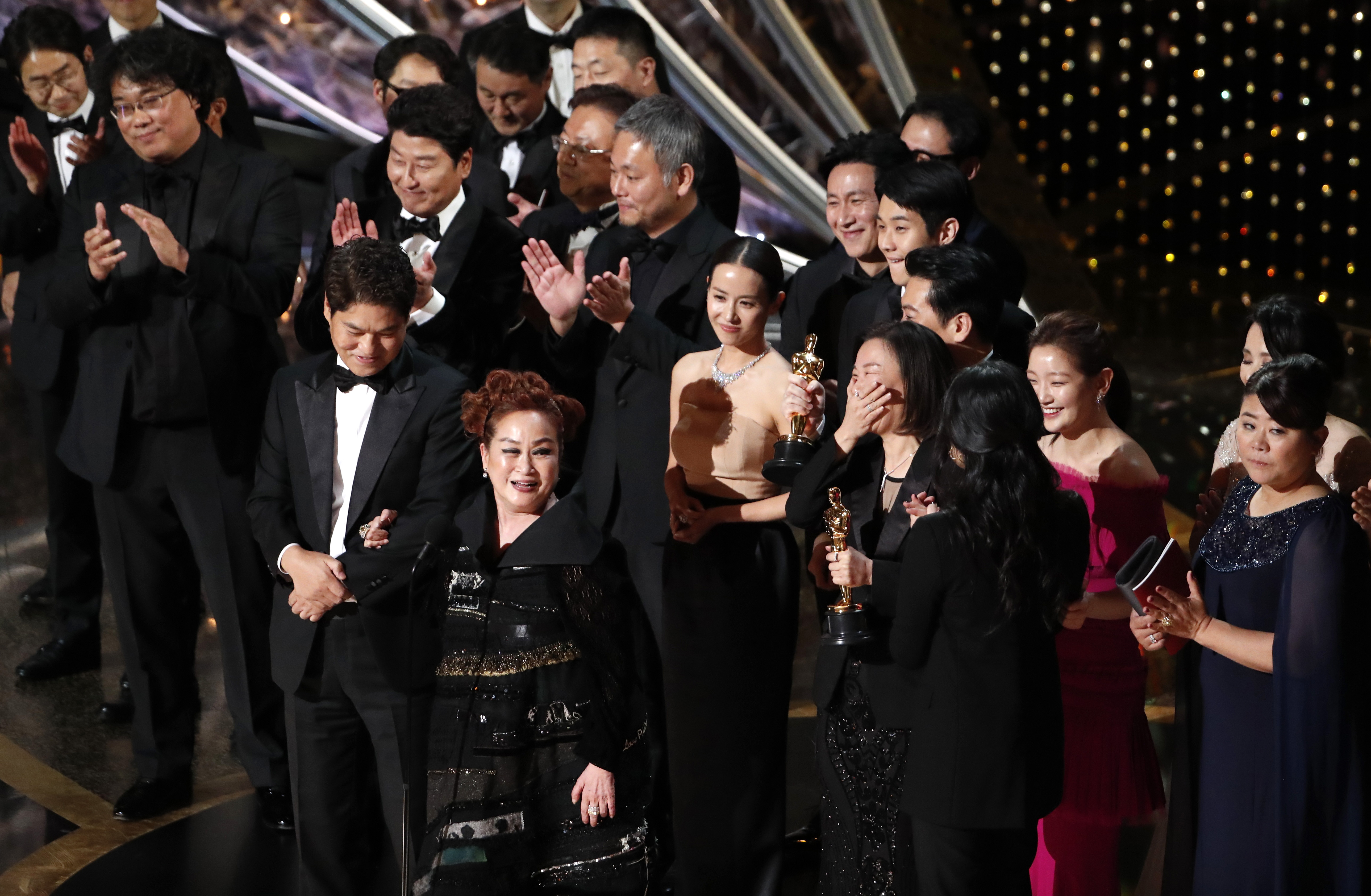 """Miky Lee, Kwak Sin Ae and Bong Joon Ho react after winning the Oscar for Best Picture for """"Parasite"""" at the 92nd Academy Awards in Hollywood, Los Angeles, California, U.S., February 9, 2020. REUTERS/Mario Anzuoni"""
