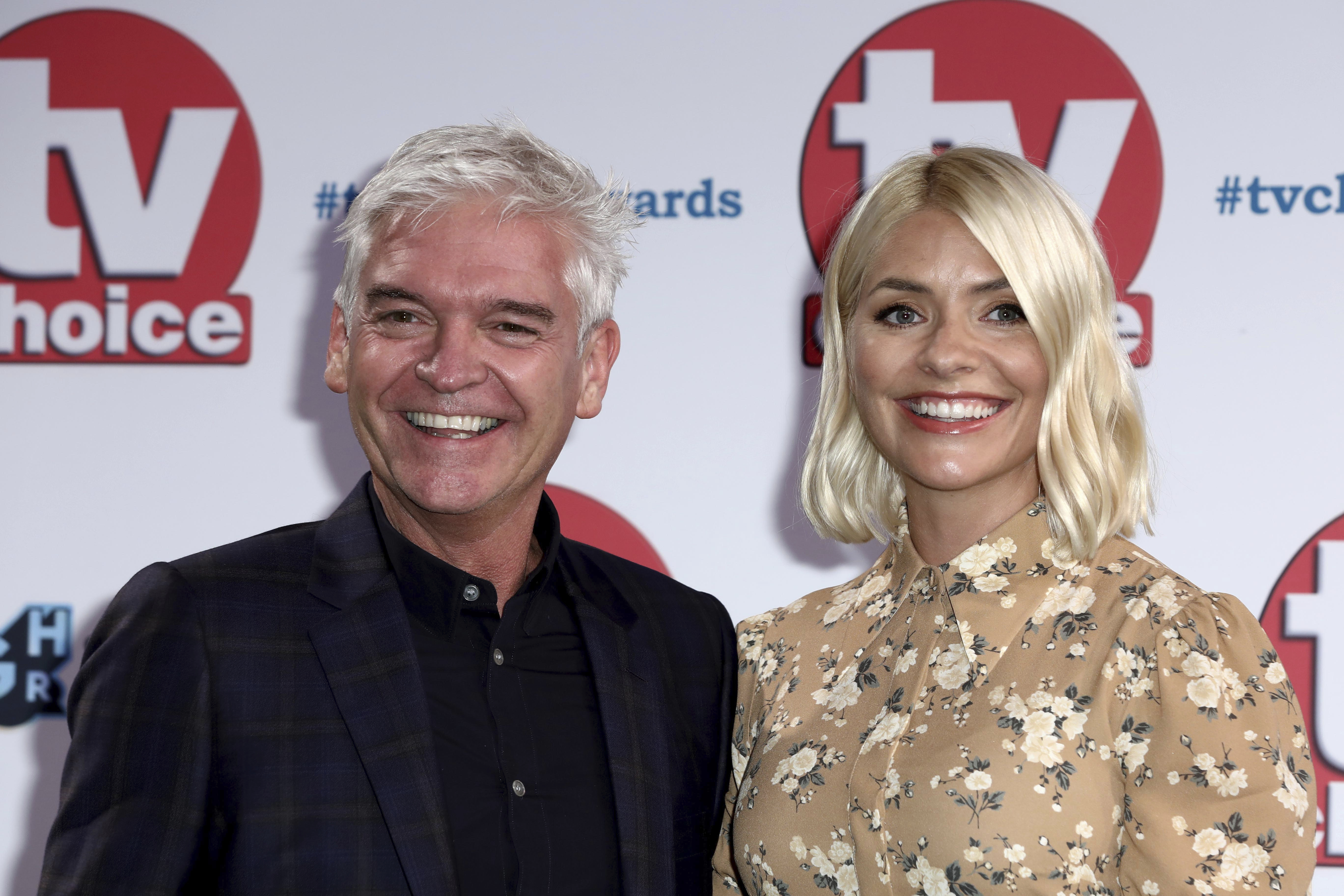TV Presenters Phillip Schofield and Holly Willoughby pose for photographers on arrival at the TV Choice Awards in central London on Monday, Sept. 9, 2019. (Photo by Grant Pollard/Invision/AP)