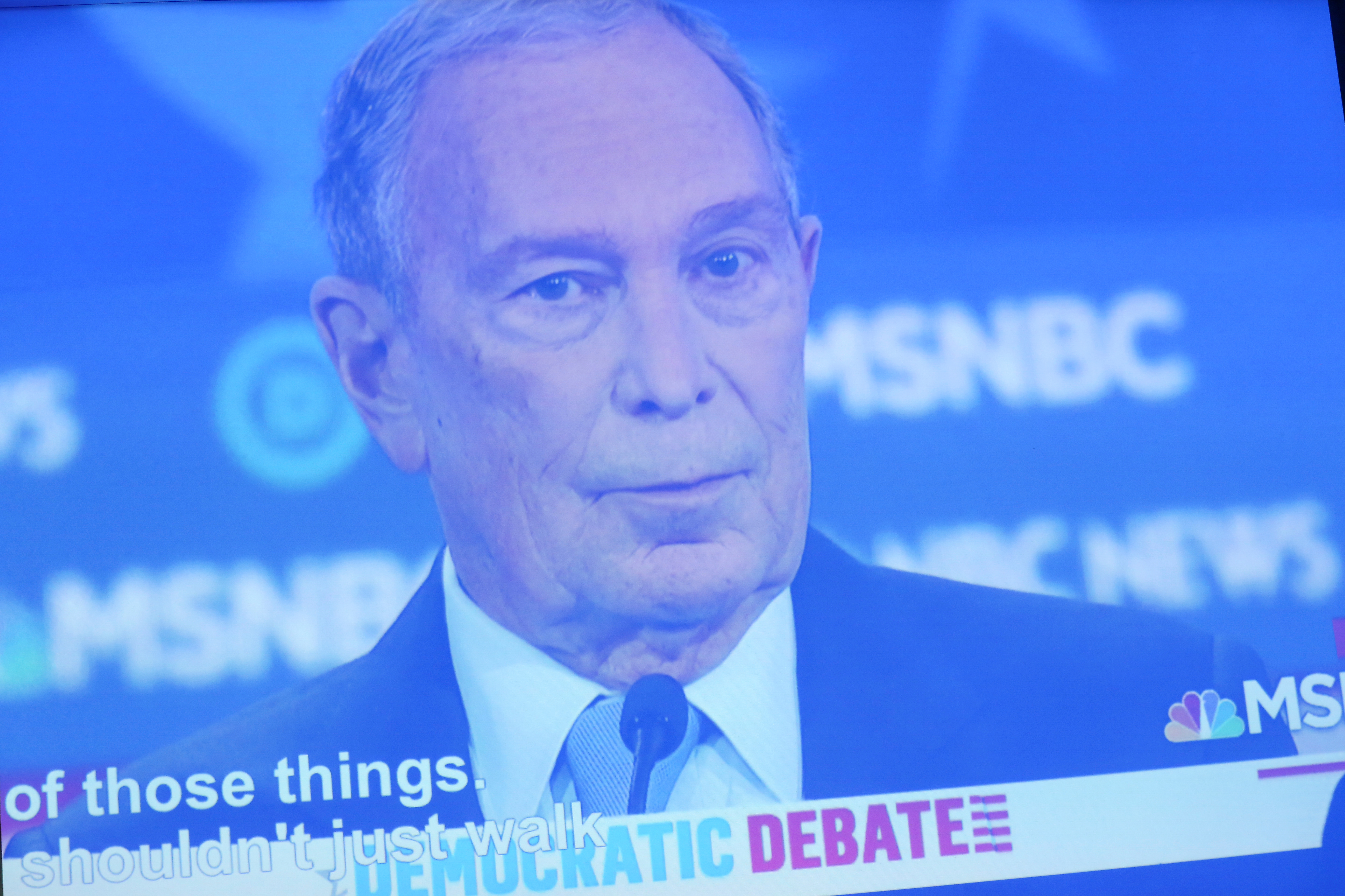 A projection of Democratic presidential candidate Michael Bloomberg as he debates is shown at his campaign office in the Brooklyn borough of New York City, New York, U.S., February 19, 2020. Picture taken February 19, 2020. REUTERS/Caitlin Ochs