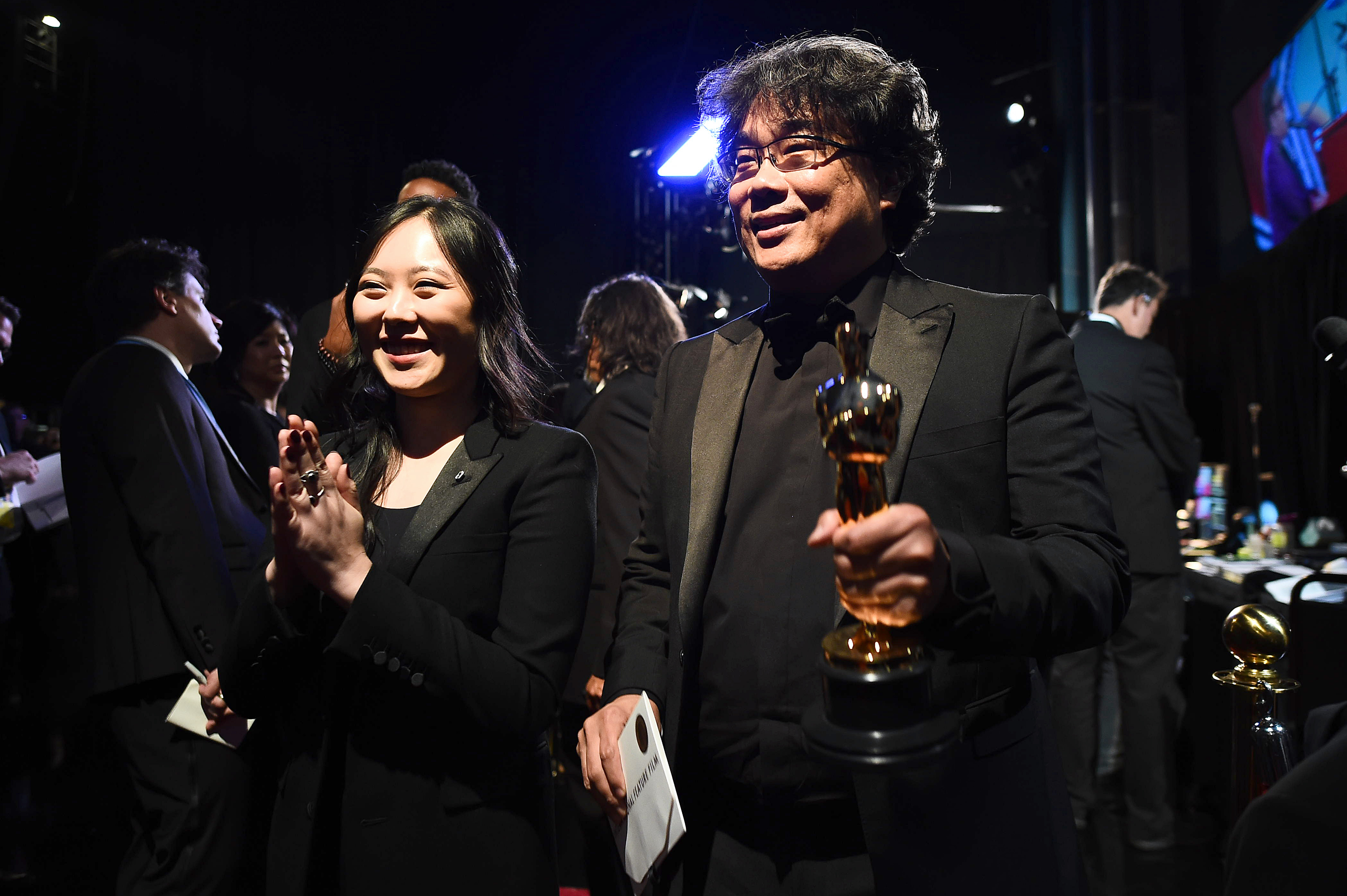 HOLLYWOOD, CALIFORNIA - FEBRUARY 09: In this handout photo provided by A.M.P.A.S. Sharon Choi and Best Director award winner Bong Joon Ho pose backstage during the 92nd Annual Academy Awards at the Dolby Theatre on February 09, 2020 in Hollywood, California. (Photo by Matt Petit - Handout/A.M.P.A.S. via Getty Images)