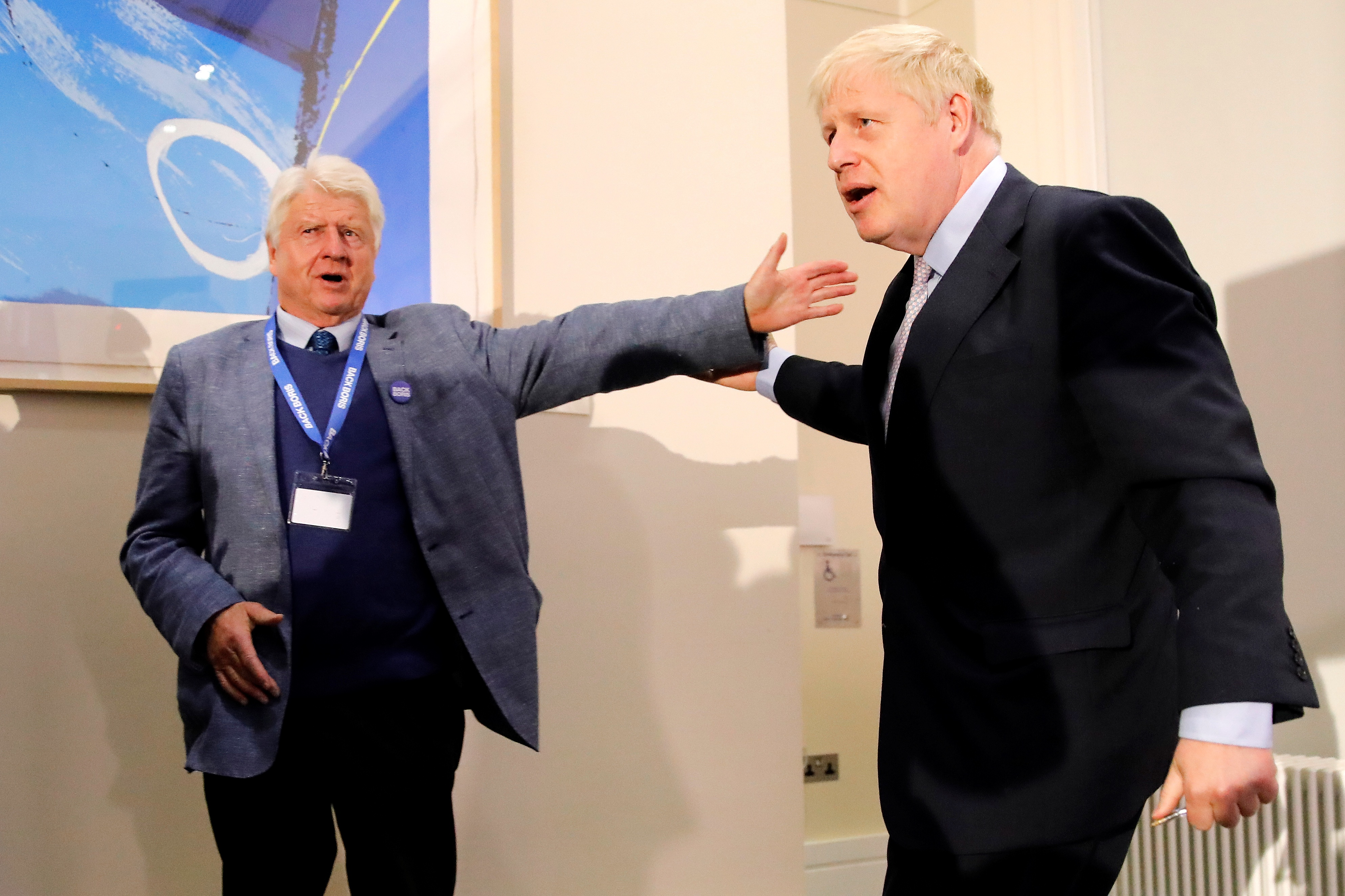 "Stanley Johnson (L), father of Conservative MP Boris Johnson, congratulates his son after he delivered his Conservative Party leadership campaign launch in London on June 12, 2019. - Boris Johnson launched his campaign Wednesday to replace Theresa May as Britain's next leader, as lawmakers moved to stop him and other hardliners from delivering a ""no deal"" Brexit. The former foreign secretary is the favourite among 10 candidates to succeed May, who quit after failing to take Britain out of the European Union on schedule. (Photo by Tolga AKMEN / AFP)        (Photo credit should read TOLGA AKMEN/AFP via Getty Images)"