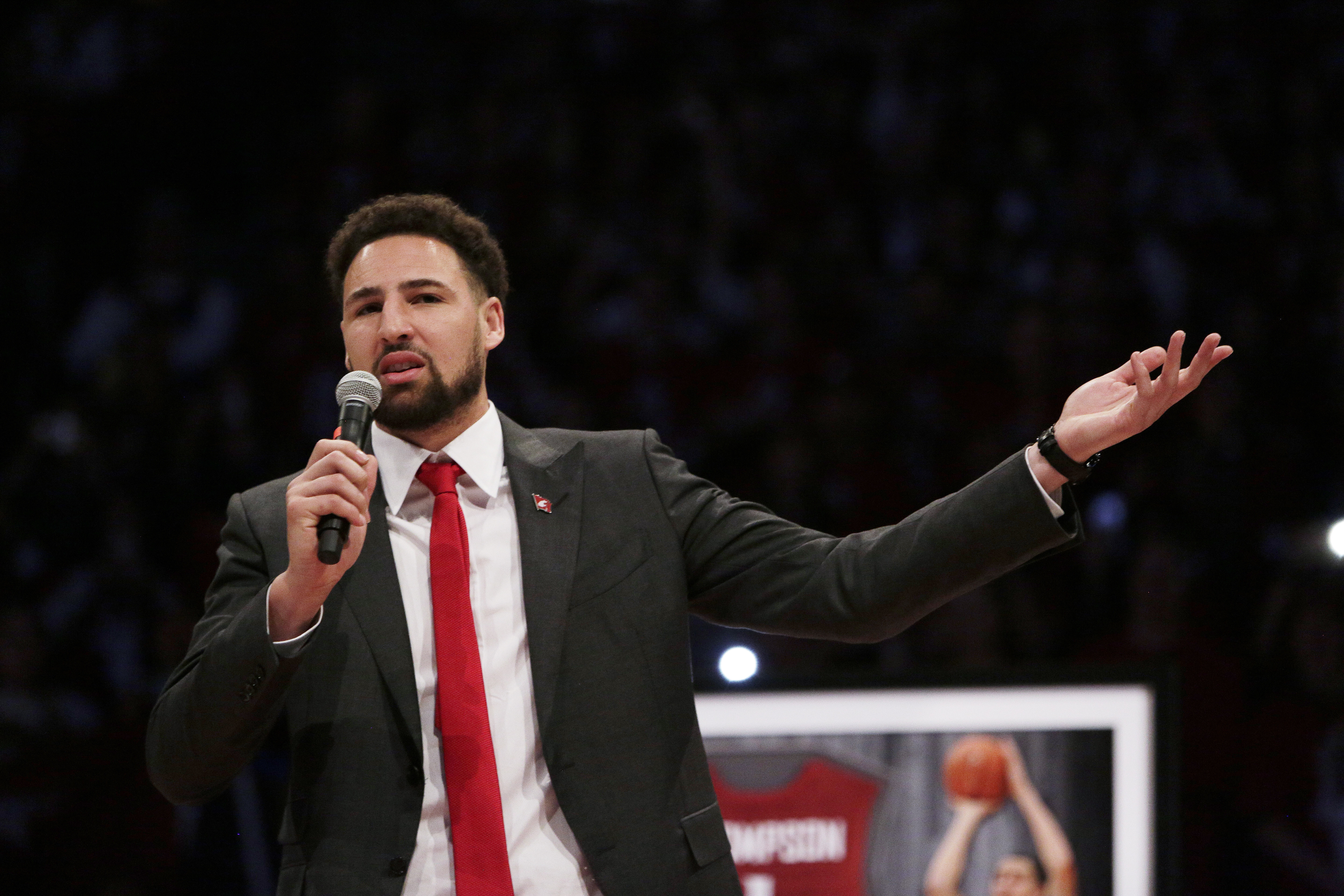 Golden State Warriors and former Washington State guard Klay Thompson speaks as the school retires his jersey number during halftime of an NCAA college basketball game between Washington State and Oregon State in Pullman, Wash., Saturday, Jan. 18, 2020. (AP Photo/Young Kwak)