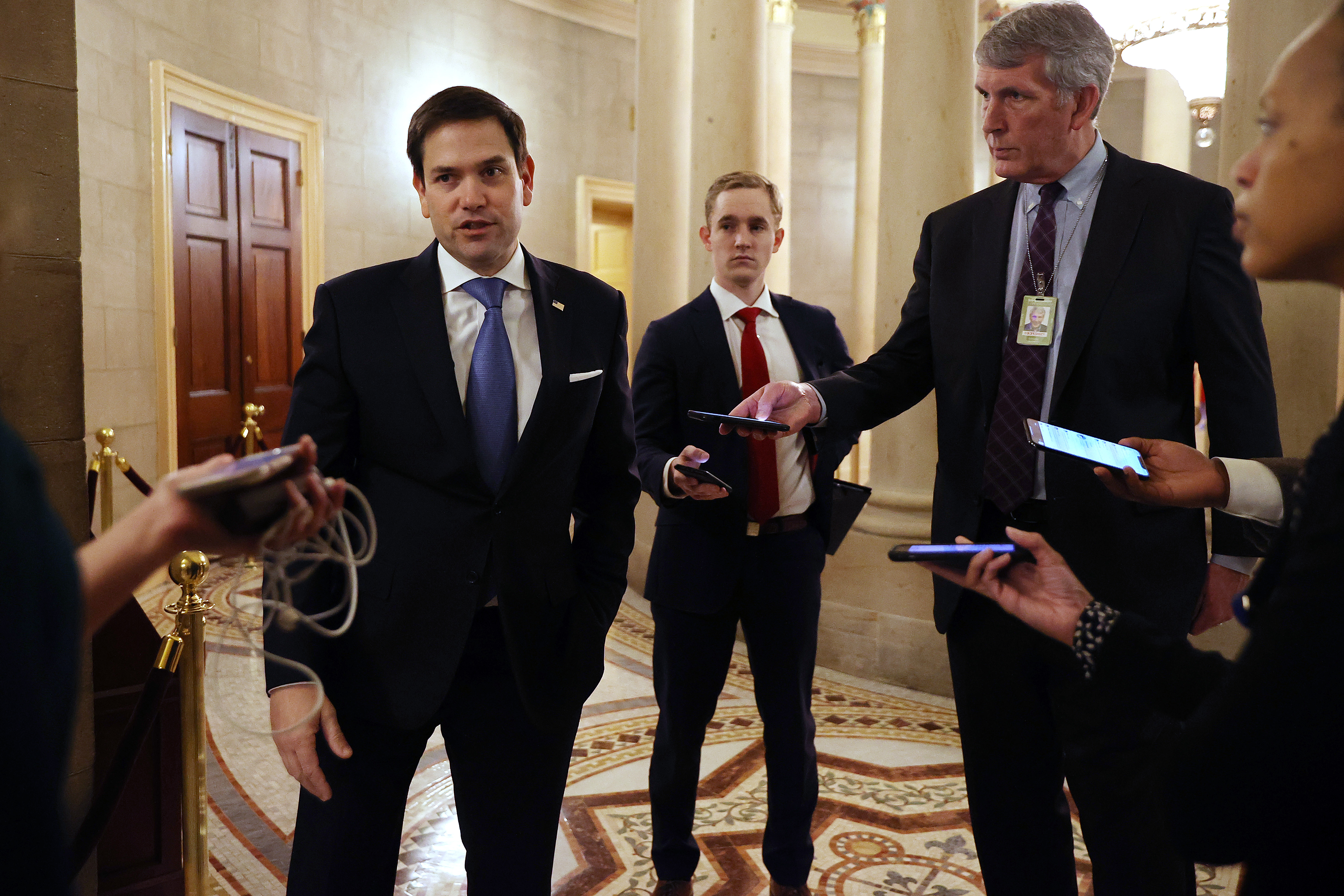 WASHINGTON, DC - MARCH 24:  Sen. Marco Rubio (R-FL) talks to reporters after leaving a meeting with fellow Republican senators and Treasury Secretary Steven Mnuchin as negotiations continue on a $2 trillion economic stimulus in response to the coronavirus pandemic March 24, 2020 in Washington, DC. After days of tense negotiations -- and Democrats twice blocking the nearly $2 trillion package -- the Senate and Treasury Department appear to have reached important compromises on legislation to shore up the economy during the COVID-19 pandemic. (Photo by Chip Somodevilla/Getty Images)