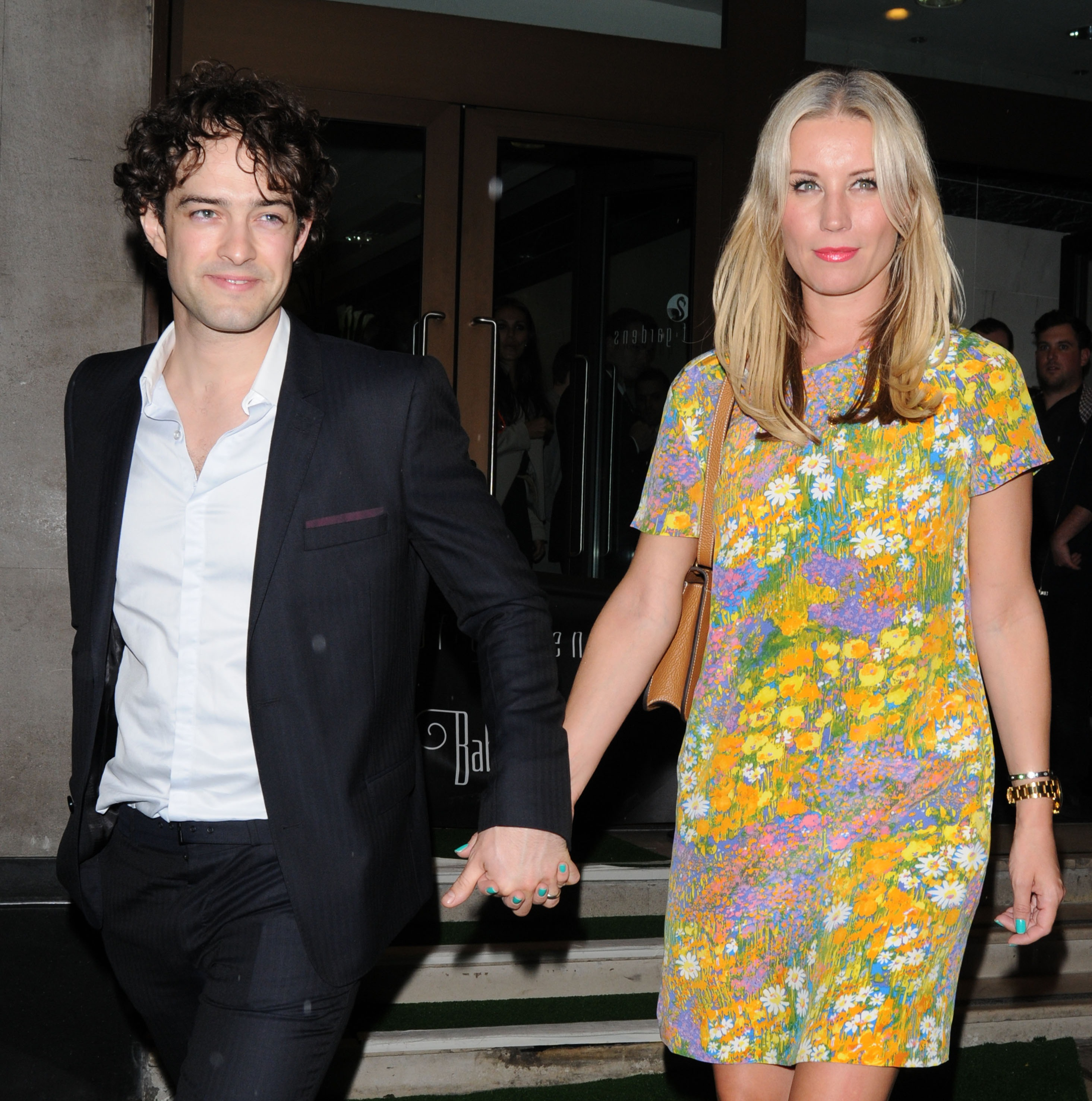 LONDON, UNITED KINGDOM - JUNE 21: Denise Van Outen and Lee Mead leaving The Pre-Wimbledon Party held at The Roof Gardens on June 21, 2012 in London, England. (Photo by Sylvia Linares/FilmMagic)