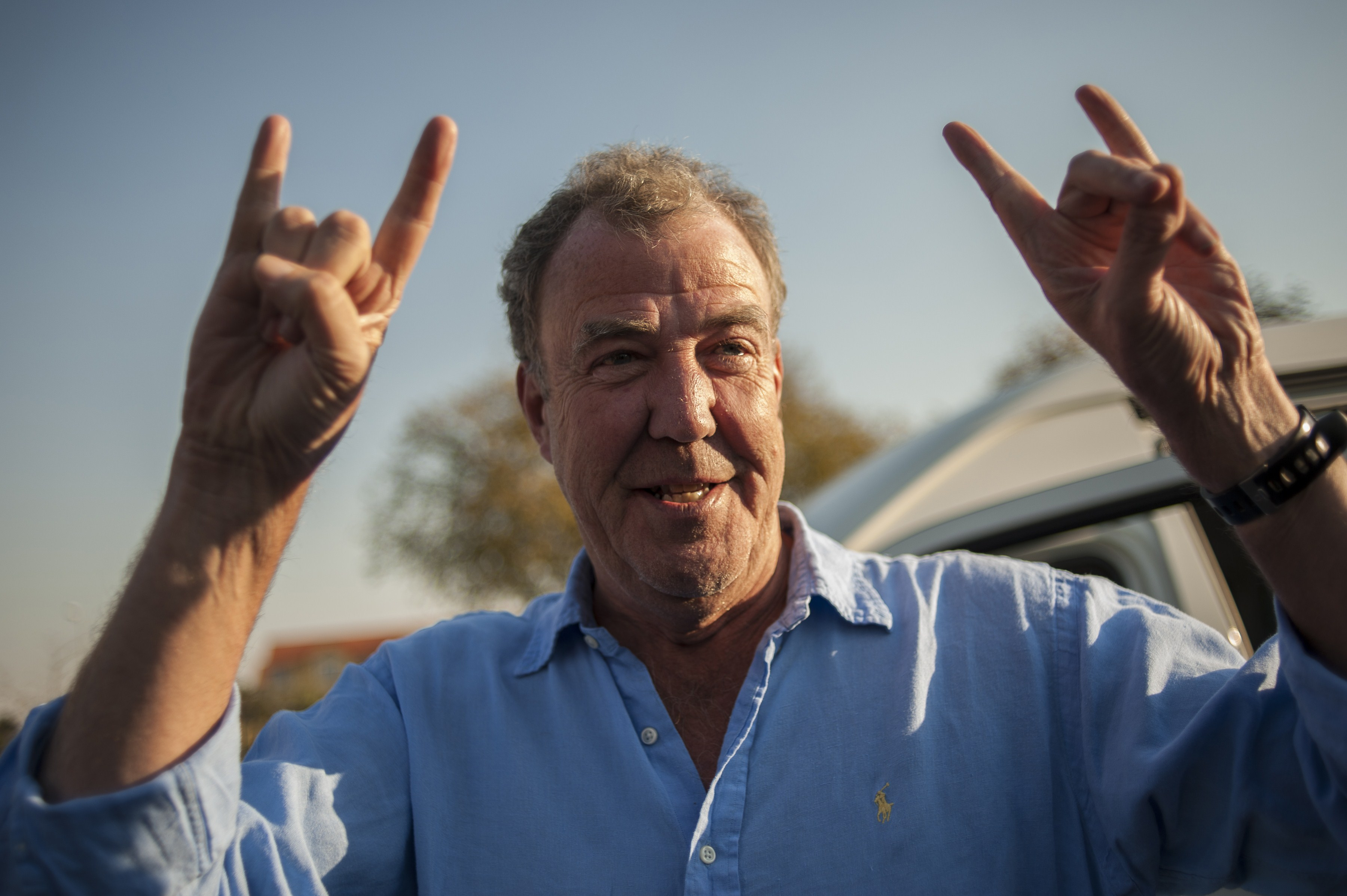 Former Top Gear presenter Jeremy Clarkson gestures as he arrives at the Ticketpro Dome for the Clarkson, Hammond and May Live Show held in Johannesburg on June 10, 2015. AFP PHOTO / STEFAN HEUNIS        (Photo credit should read STEFAN HEUNIS/AFP via Getty Images)