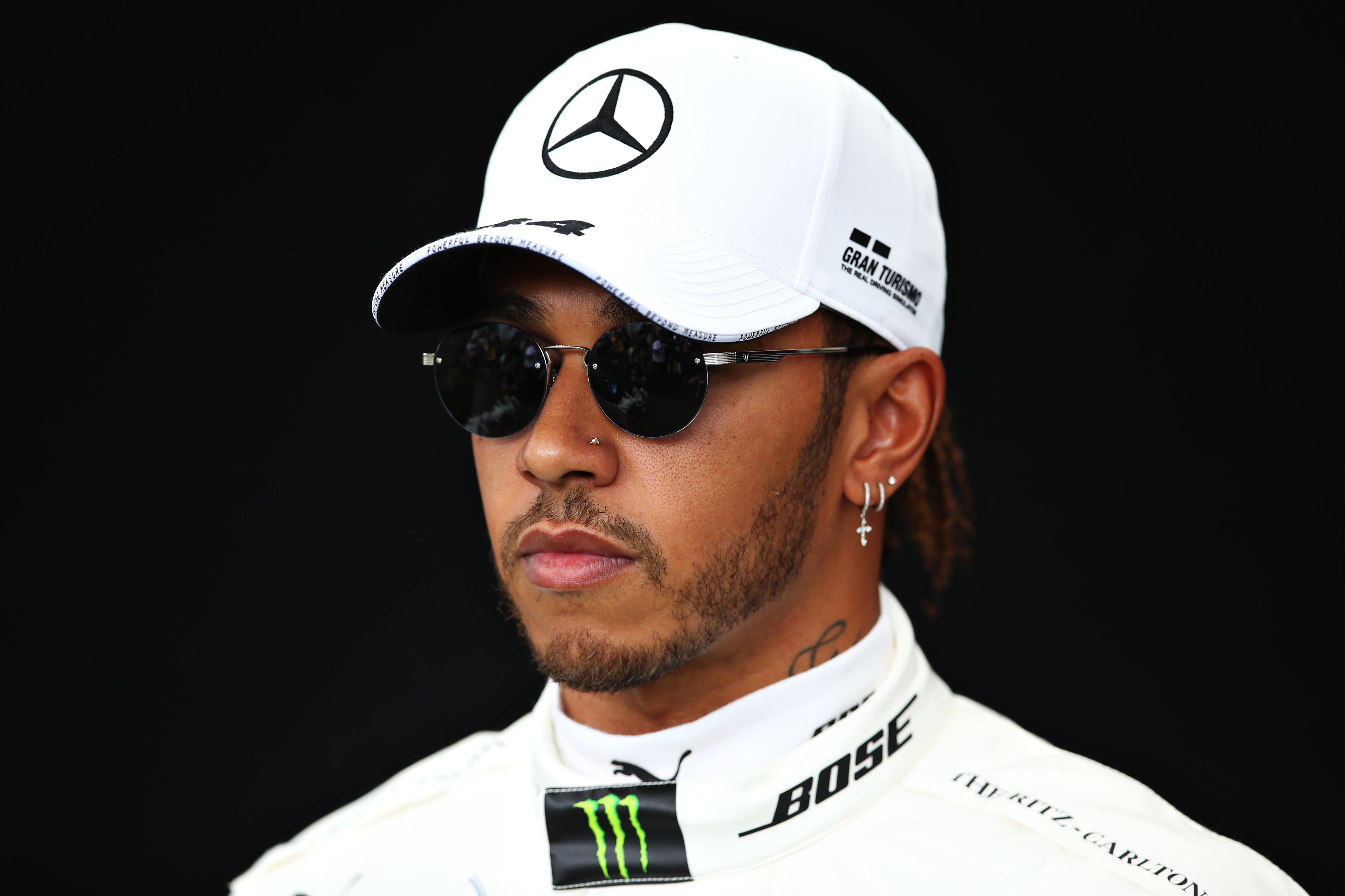 MELBOURNE, AUSTRALIA - MARCH 12: Lewis Hamilton of Great Britain and Mercedes GP poses for a photo in the Paddock during previews ahead of the F1 Grand Prix of Australia at Melbourne Grand Prix Circuit on March 12, 2020 in Melbourne, Australia. (Photo by Charles Coates/Getty Images)